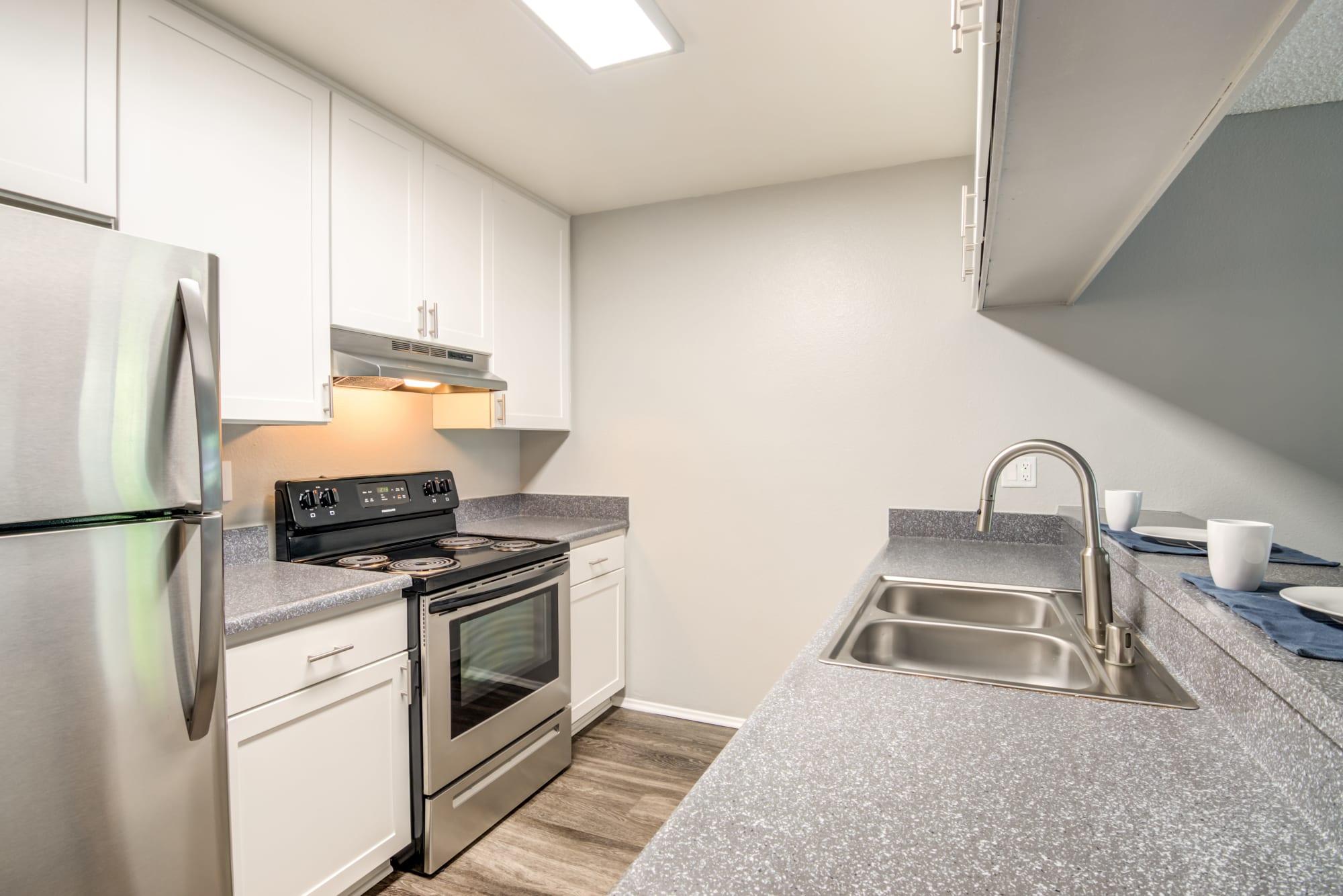 White renovated kitchen At Hillside Terrace Apartments