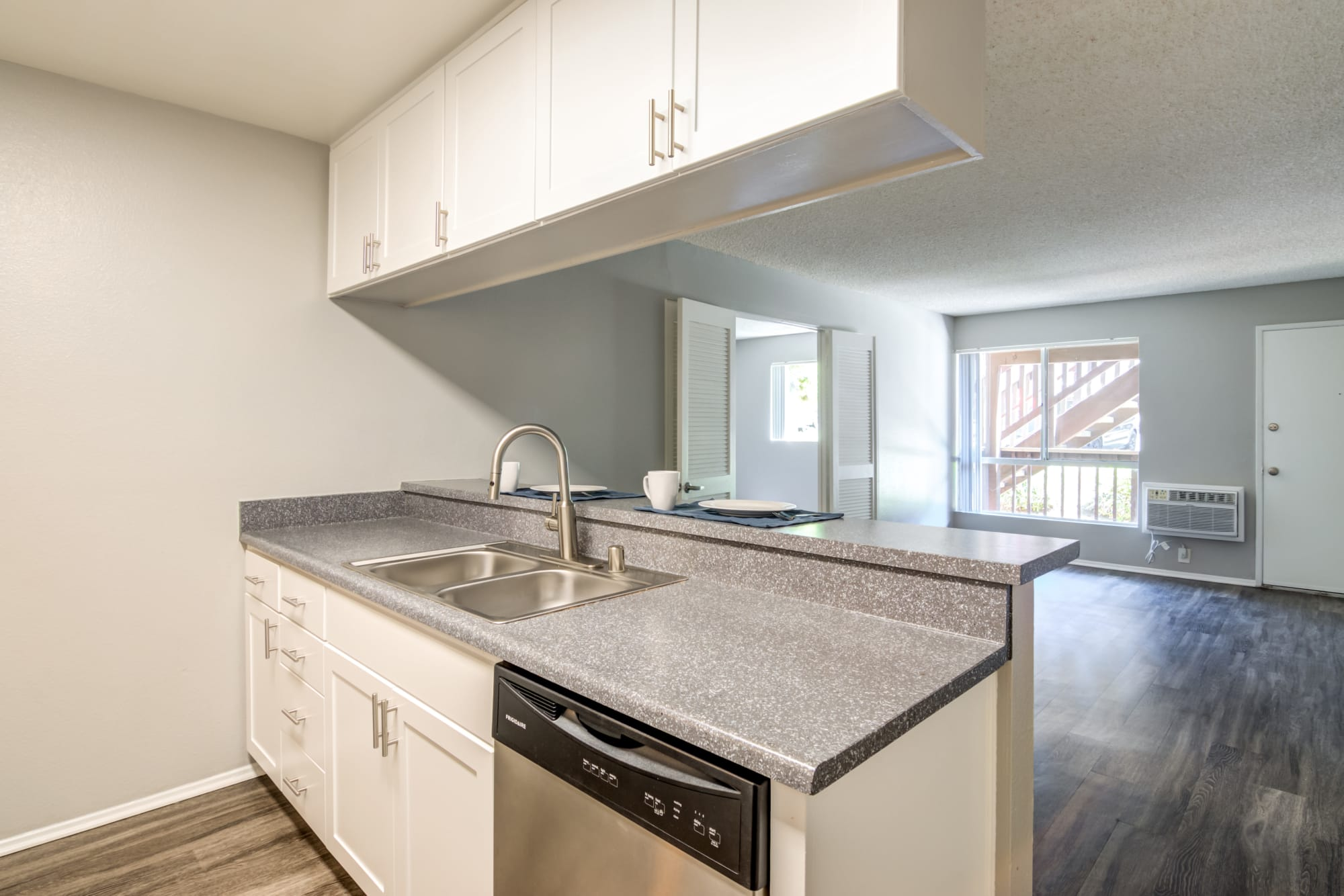 white renovated kitchen looking into open living room At Hillside Terrace Apartments