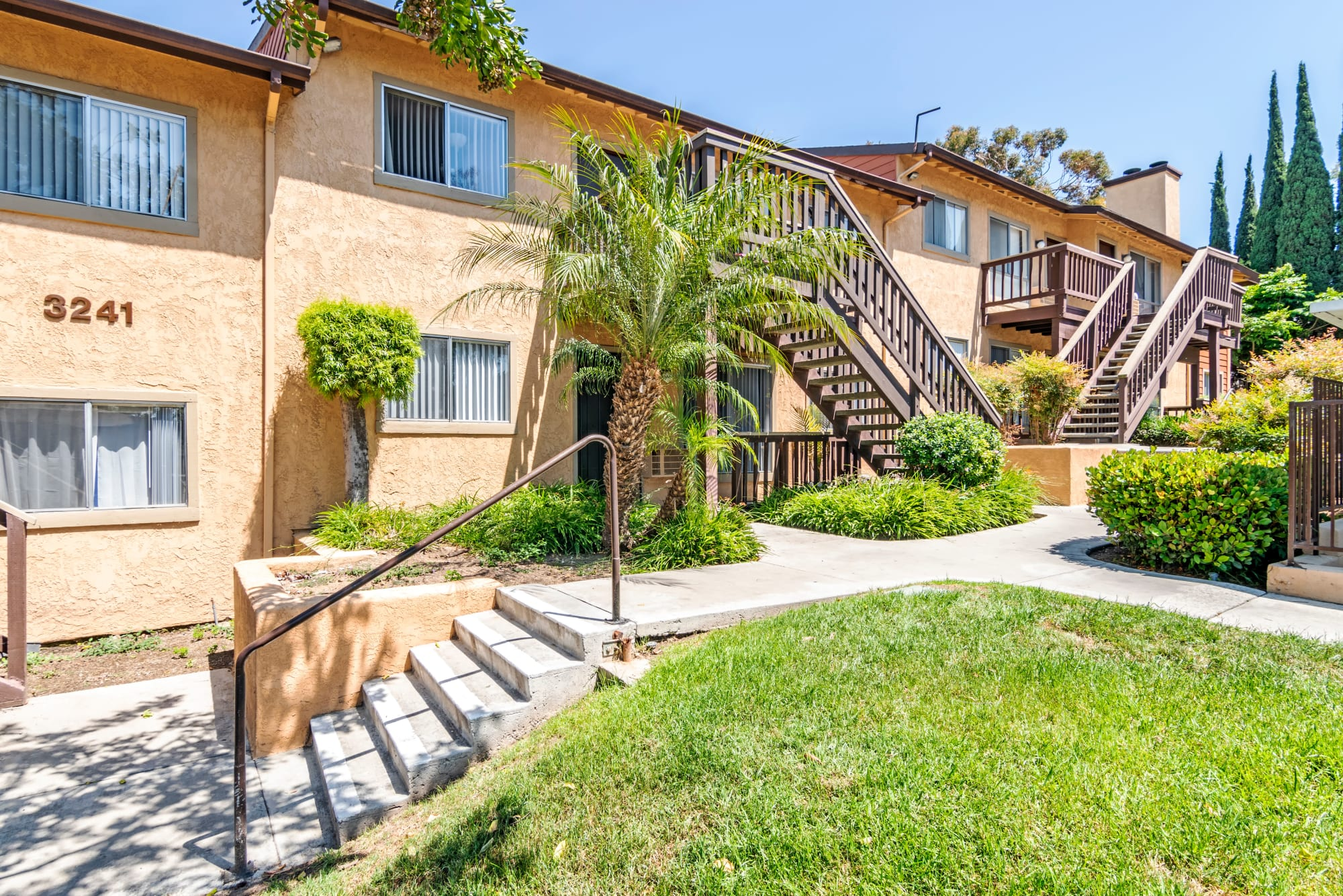Walkways through the landscaped property at Hillside Terrace Apartments in Lemon Grove, California
