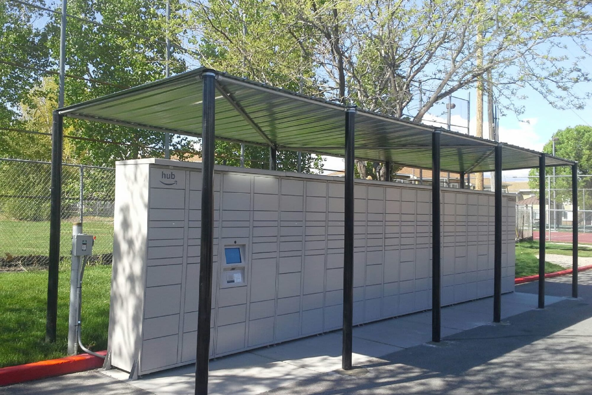 Covered outdoor package lockers at Callaway Apartments in Taylorsville, Utah