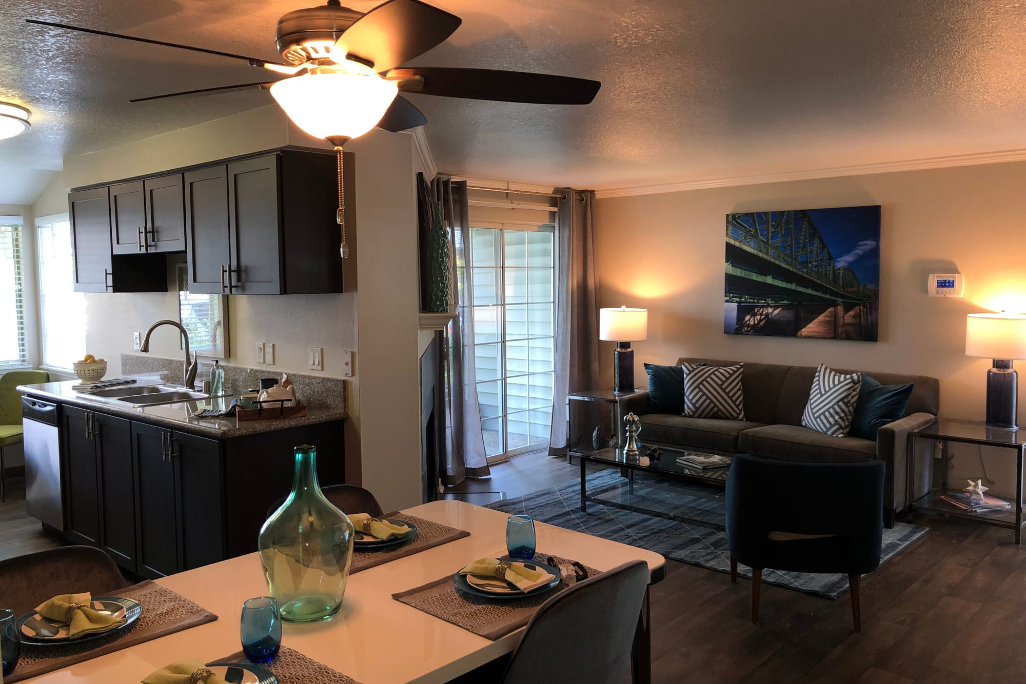 View of Dining Room, living room, and dining room fully furnished at Walnut Grove Landing Apartments in Vancouver, WA