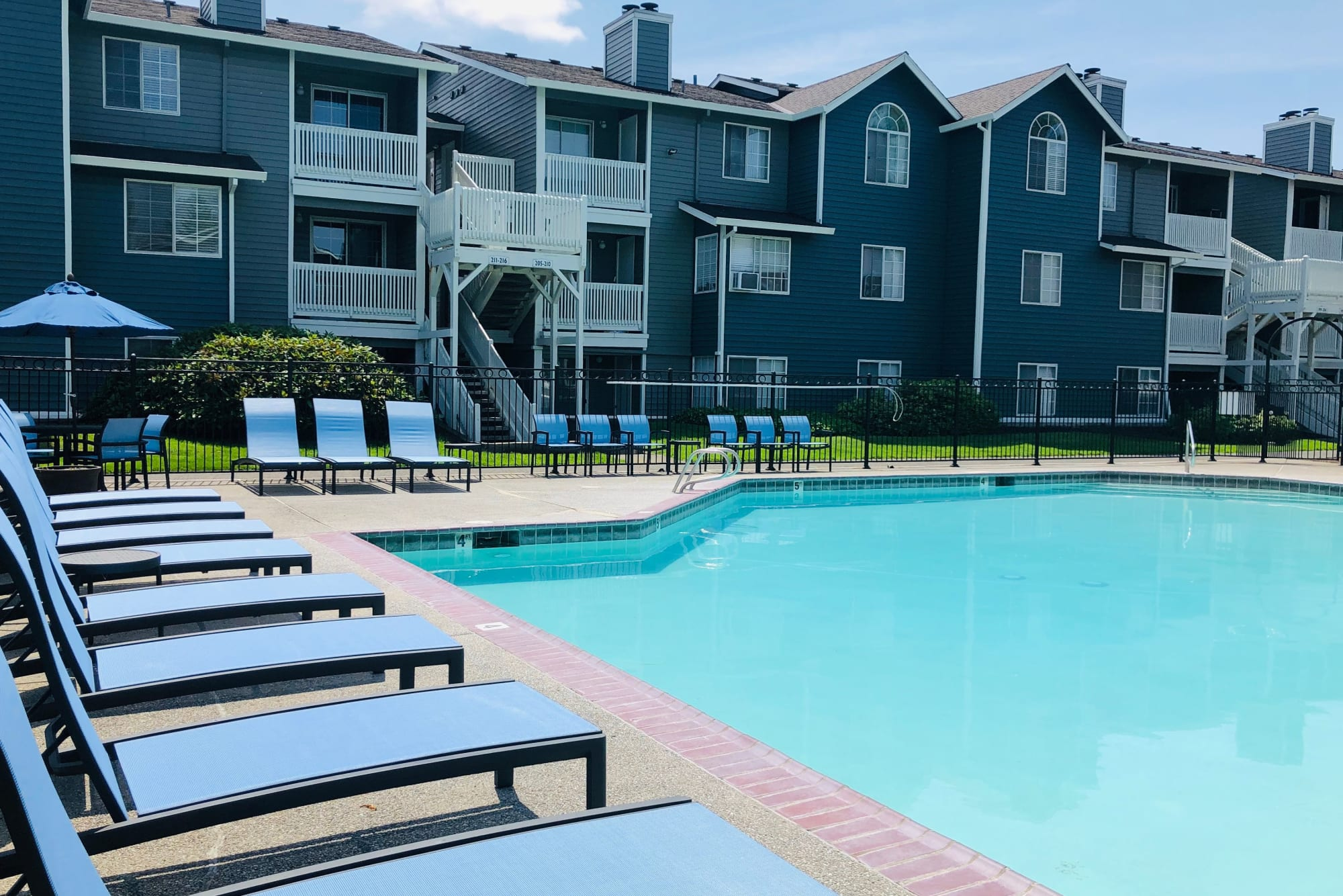 Sparkling Pool with new lounge chairs at Walnut Grove Landing Apartments in Vancouver, WA