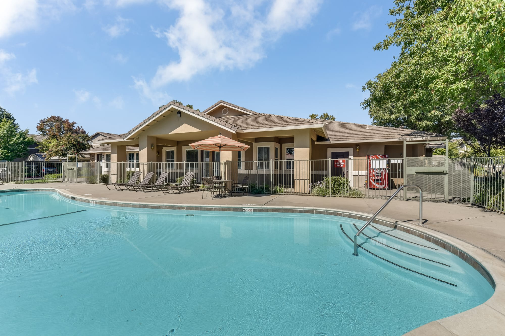 The pool and clubhouse at Natomas Park Apartments in Sacramento, California