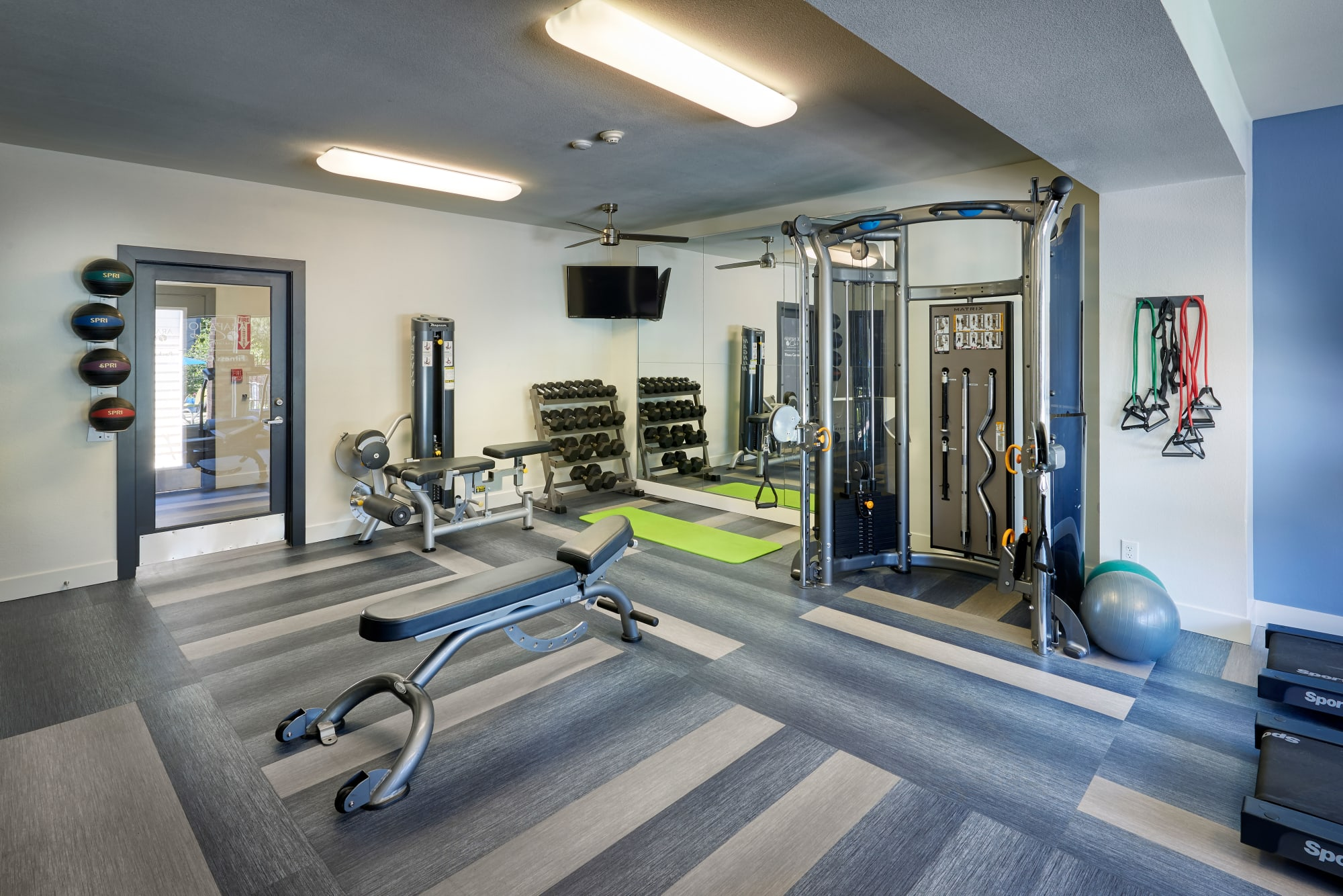 fitness center with weights and machines