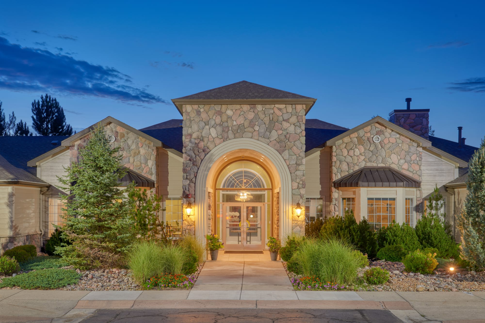 Exterior view of leasing office entrance at Legend Oaks Apartments in Aurora, Colorado