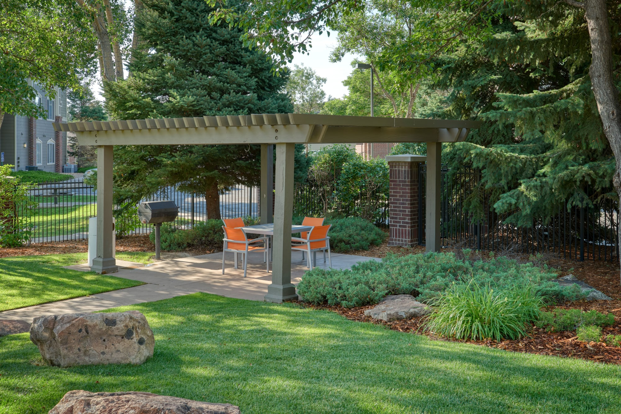Barbecue picnic area at Legend Oaks Apartments in Aurora, Colorado