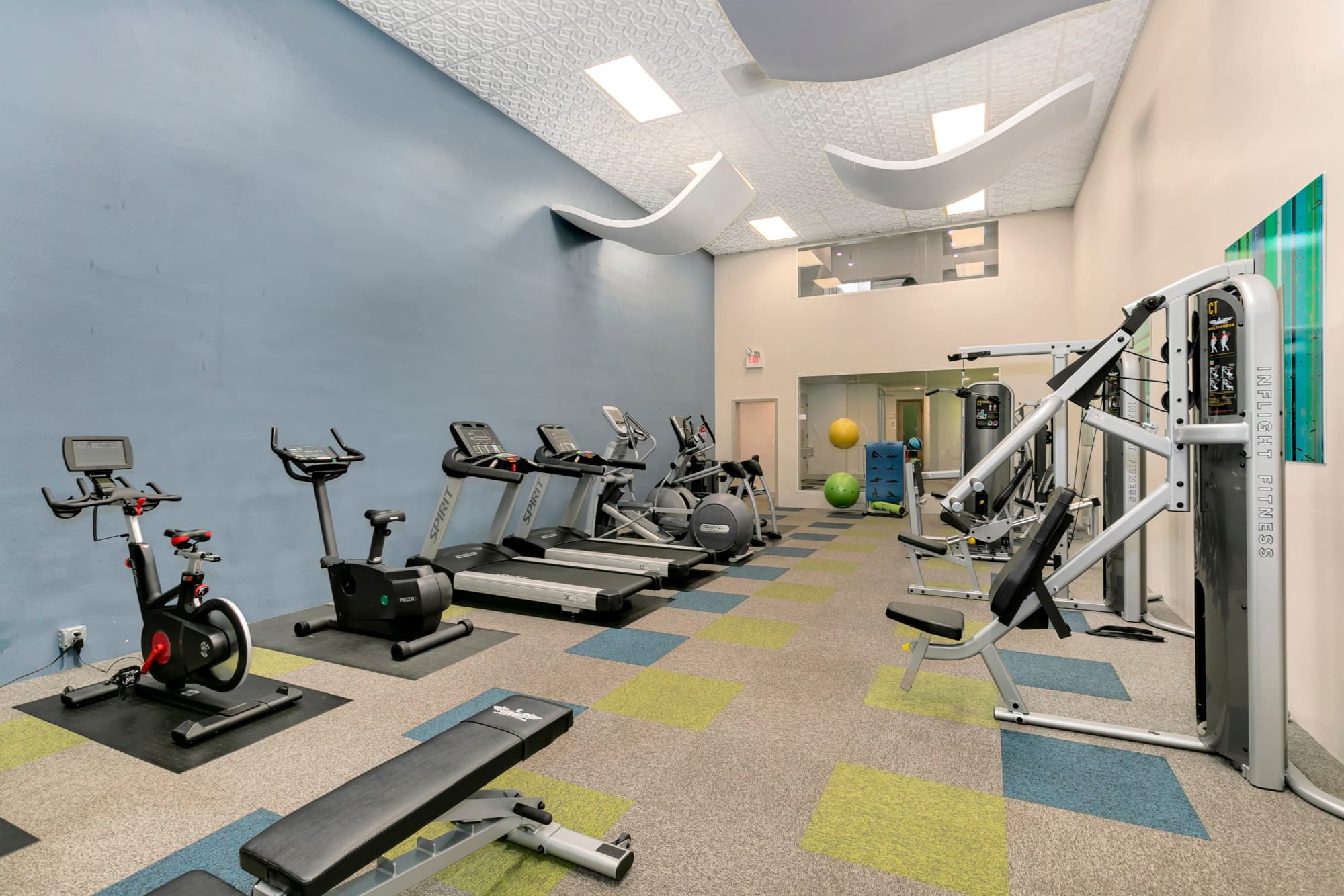 Fitness center with cardio and weight machines at Autumn Chase Apartments in Vancouver, Washington