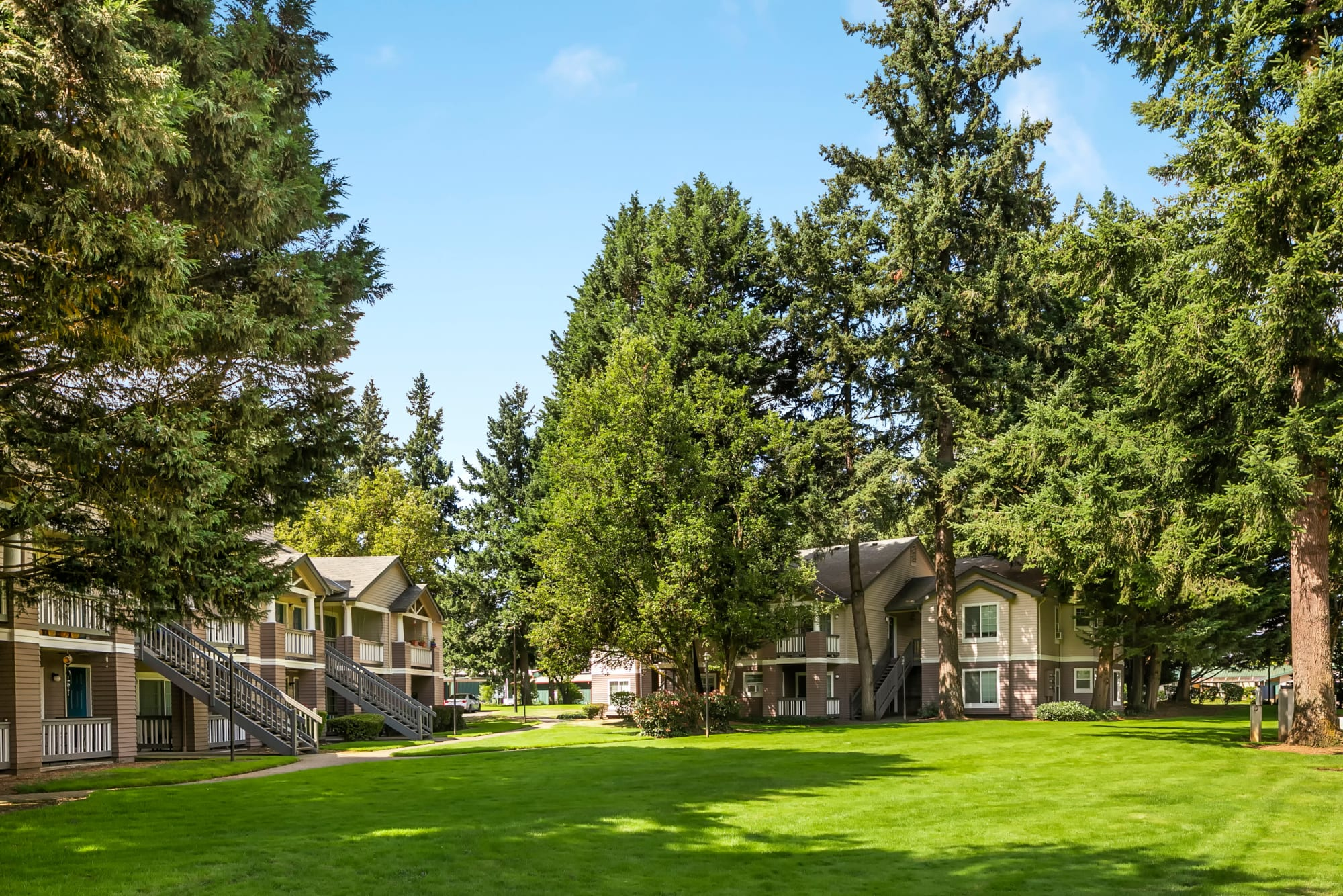 The building exterior and lush landscaping at Autumn Chase Apartments in Vancouver, Washington