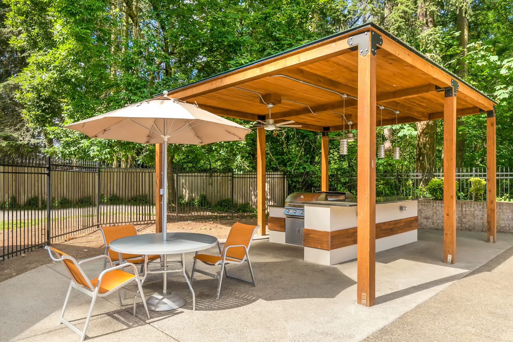 Seating near the covered outdoor barbecue area at Autumn Chase Apartments in Vancouver, Washington
