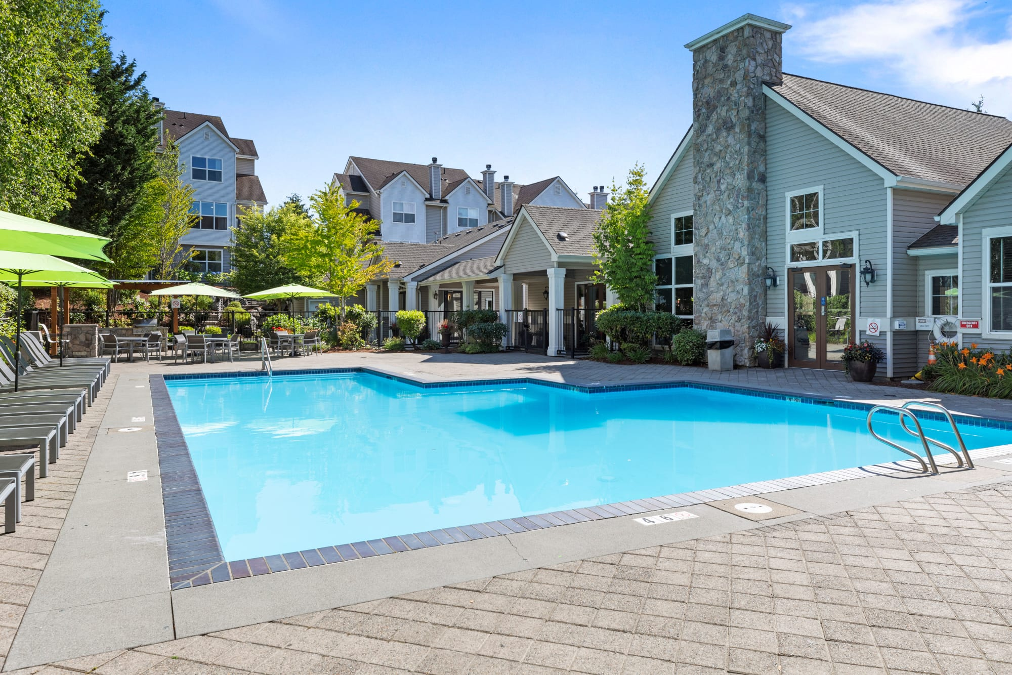 Expansive pool and deck at HighGrove Apartments in Everett, Washington