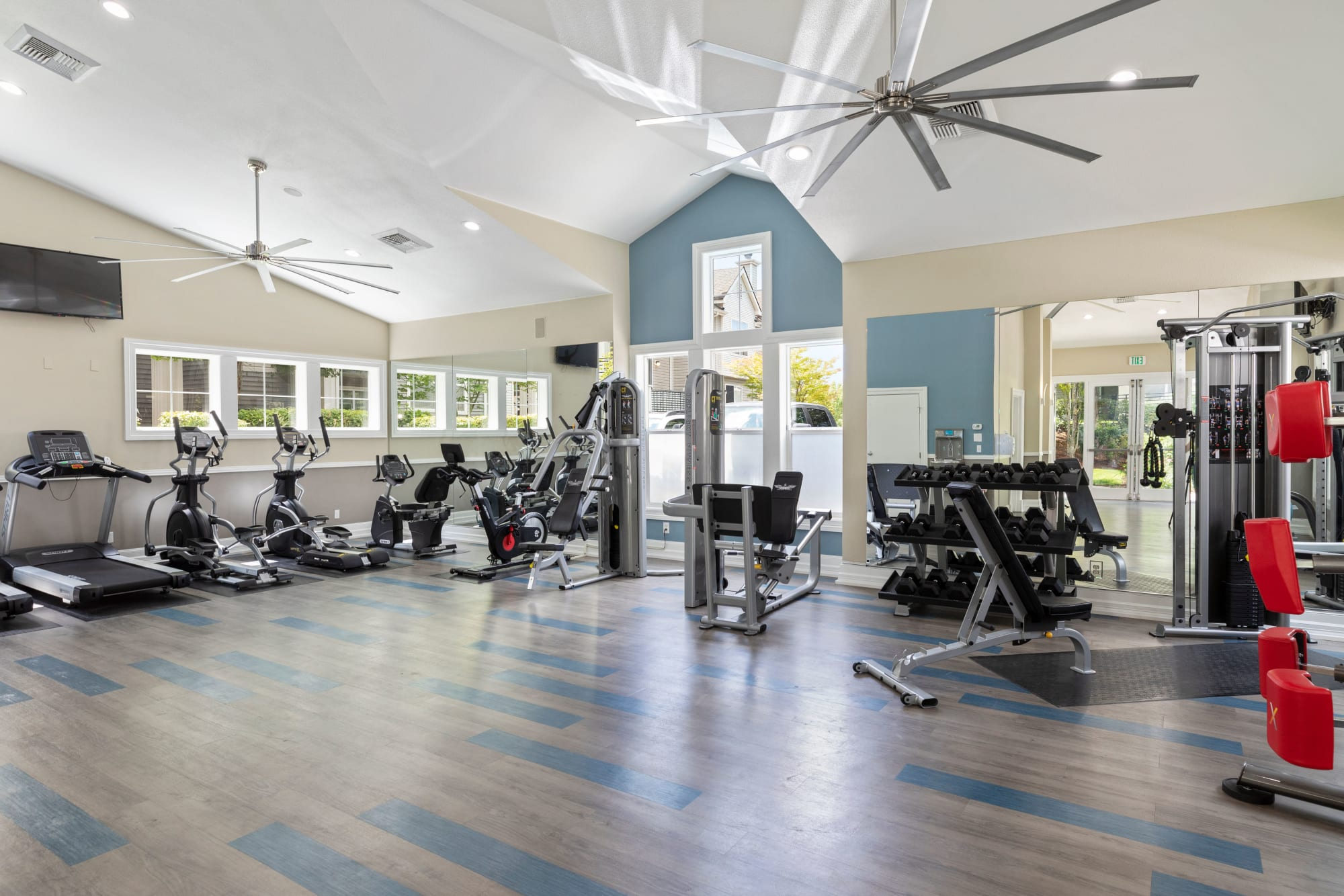 The fully equipped fitness center at HighGrove Apartments in Everett, Washington