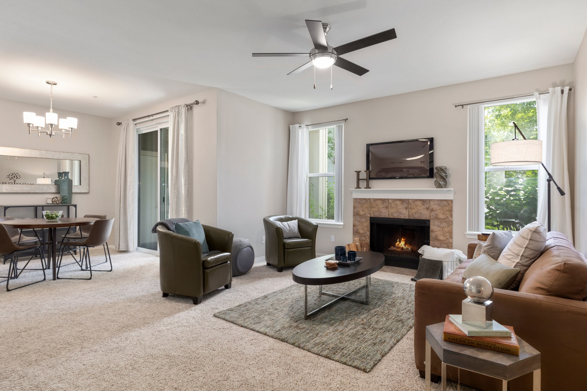 Living Room with fireplace and view of dining room at HighGrove Apartments in Everett, WA