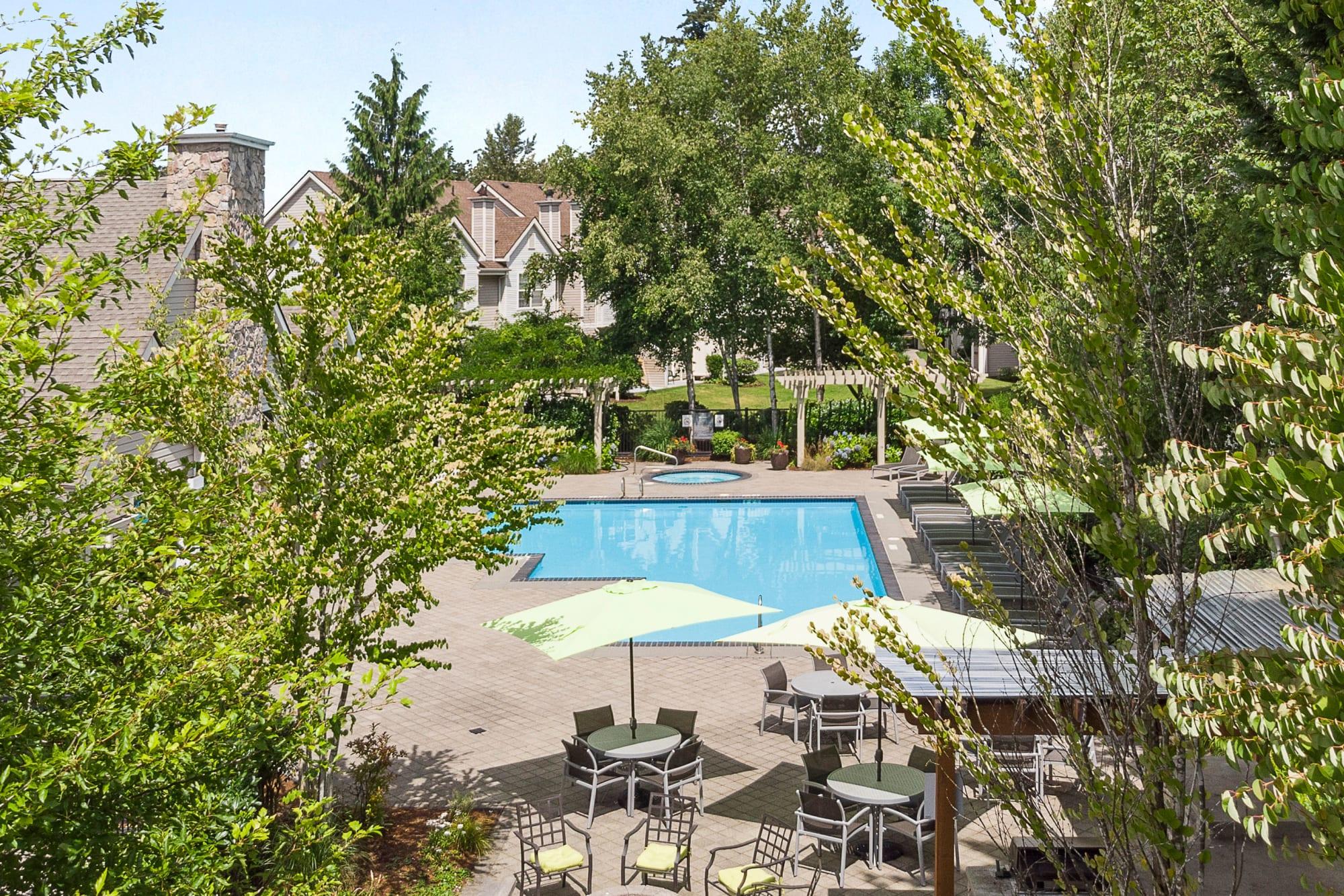 Lush landscaping around the pool at HighGrove Apartments in Everett, Washington