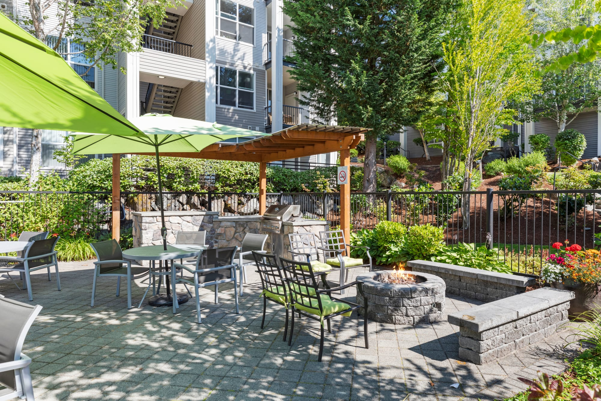 Poolside fire pit area at HighGrove Apartments in Everett, Washington