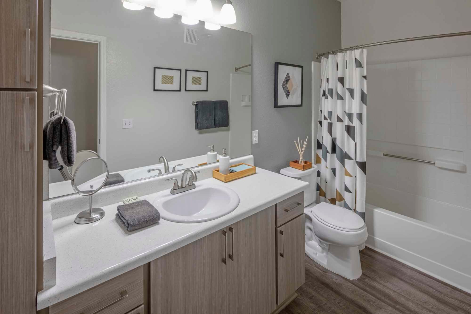A bathroom with a shower, sink and lots of counter space at The Grove at Orenco Station in Hillsboro, Oregon