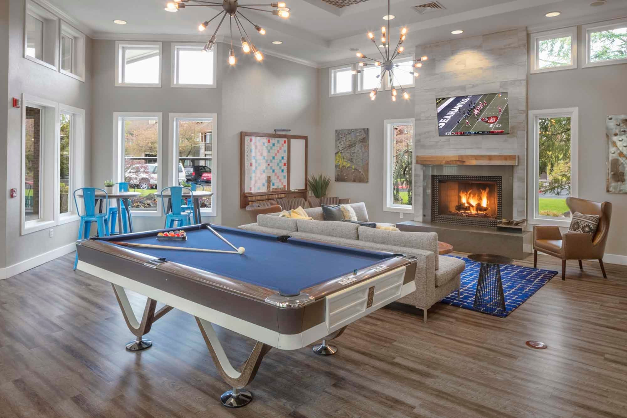 The clubhouse with pool table and hardwood floors at The Grove at Orenco Station in Hillsboro, Oregon