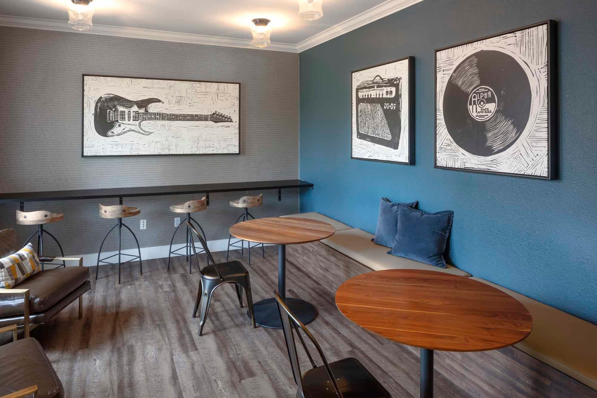 A common area with coffee tables and decorated with framed albums at The Grove at Orenco Station in Hillsboro, Oregon