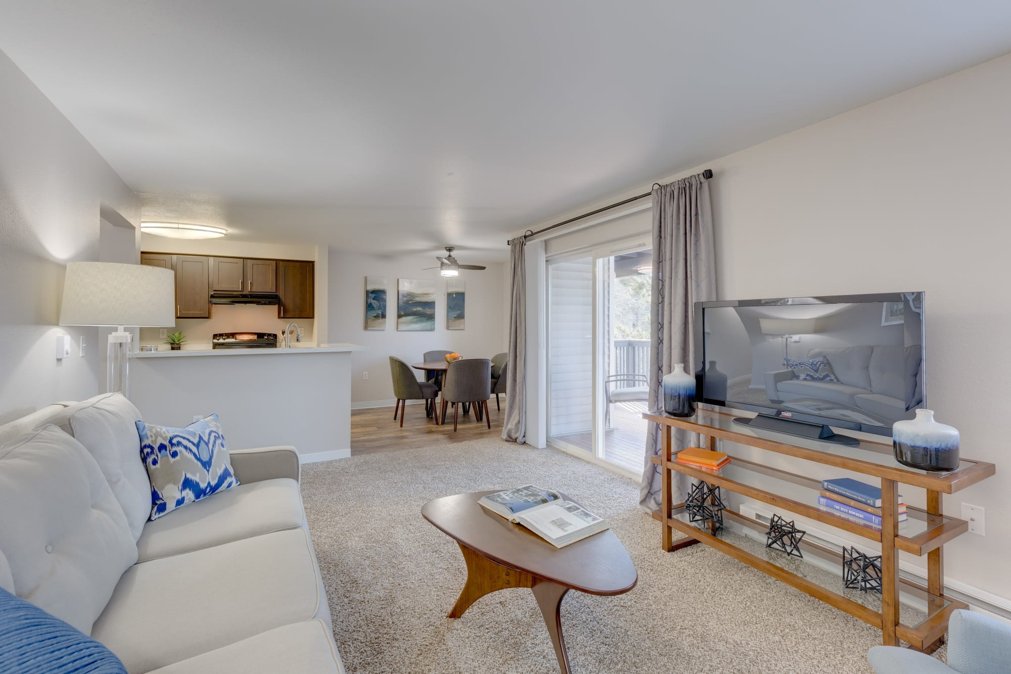 A fully furnished living room with flat screen television and modern furniture at Cascade Ridge in Silverdale, Washington