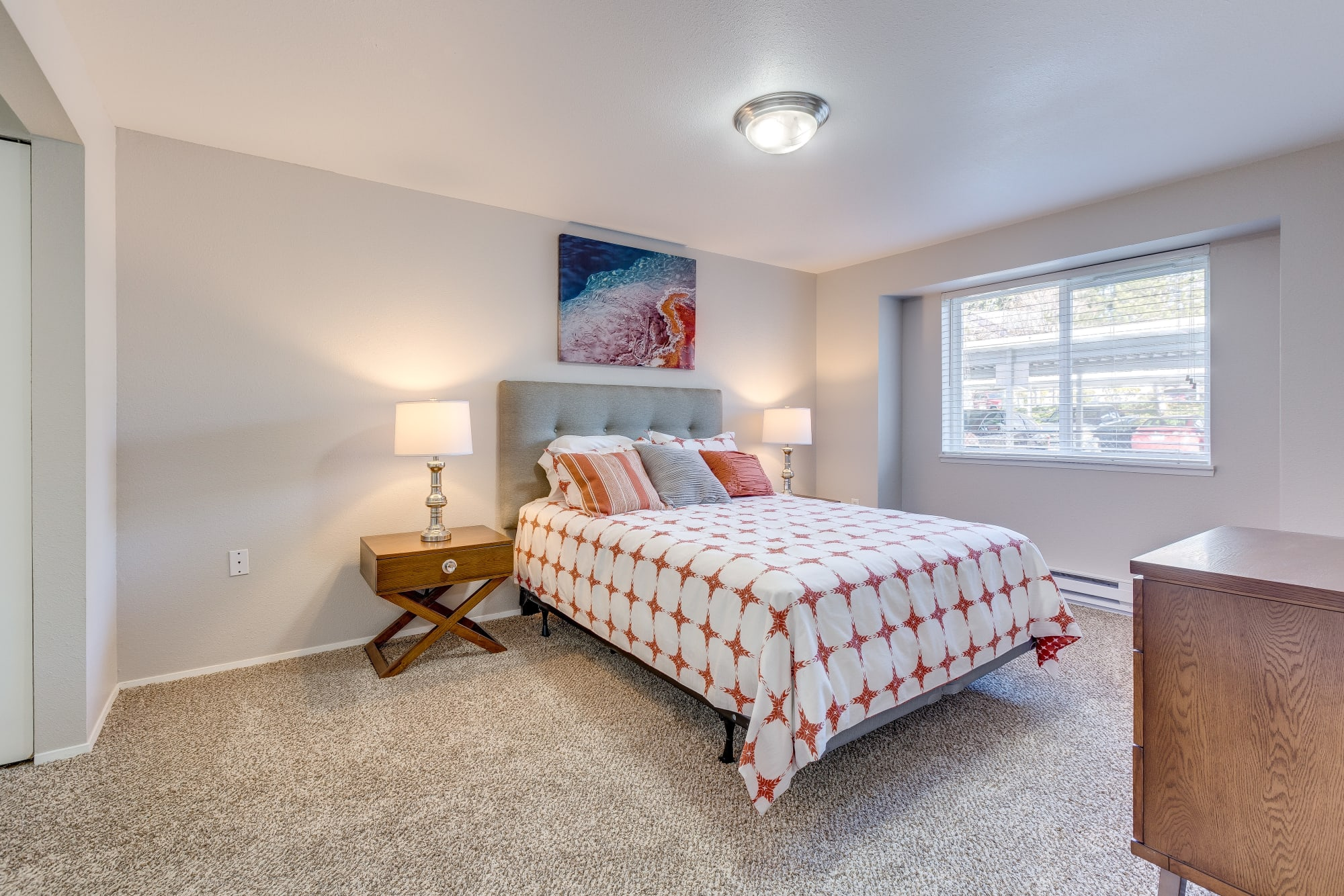 A bedroom with carpet and new furniture at Cascade Ridge in Silverdale, Washington