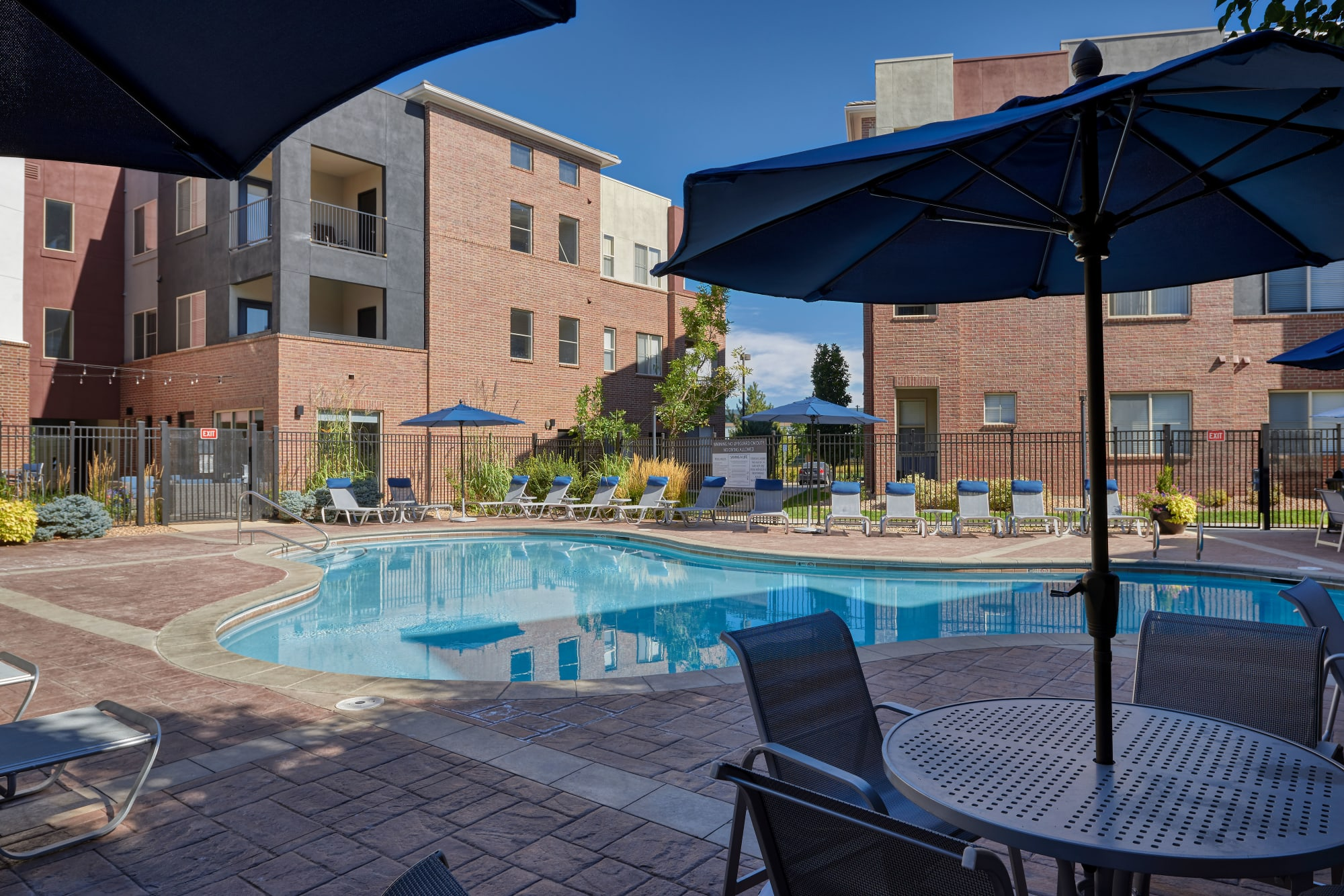 A swimming pool and spa that is great for entertaining at The Rail at Inverness in Englewood, CO