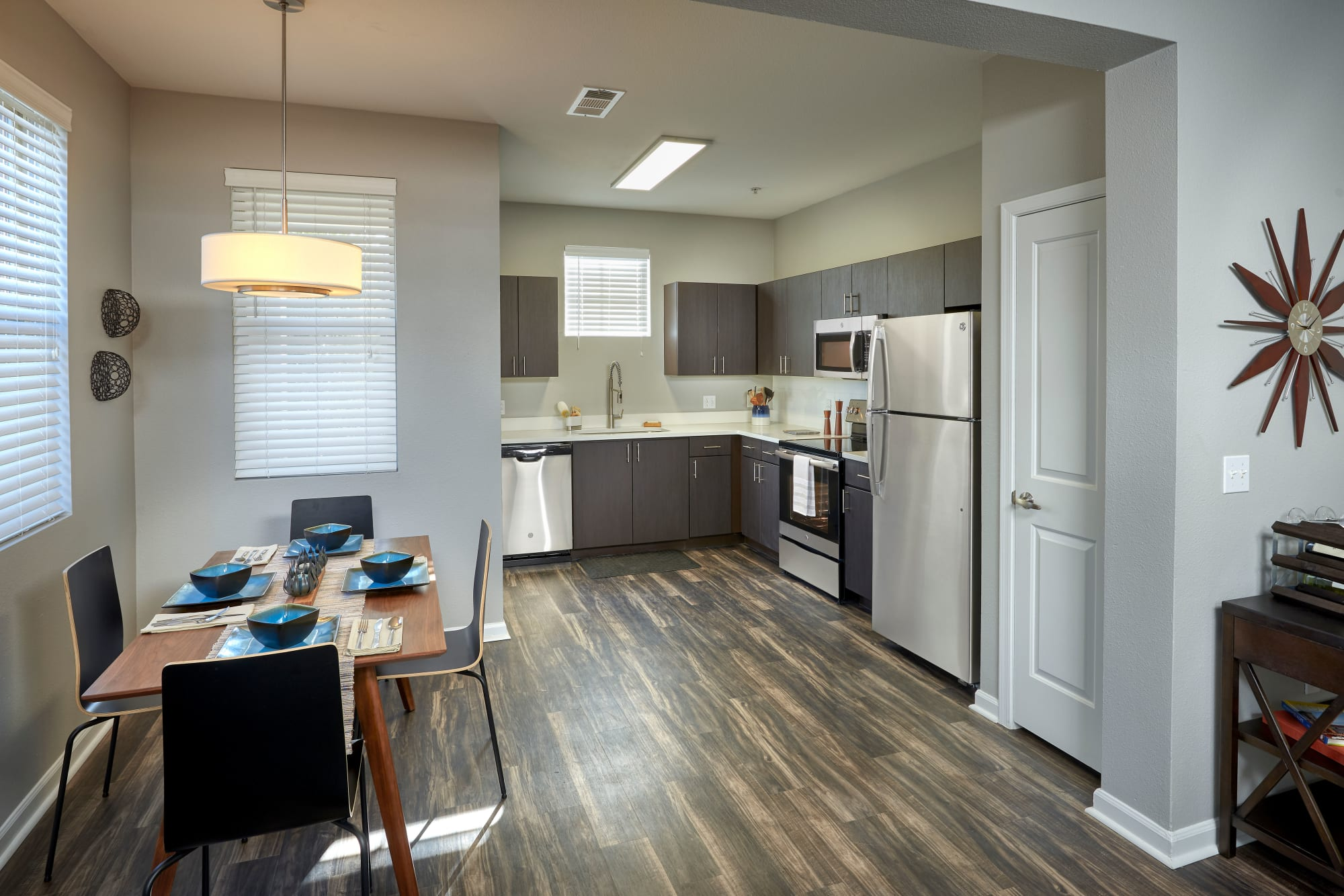 Cozy kitchen with brown renovation and stainless steel appliances at The Rail at Inverness in Englewood, Colorado