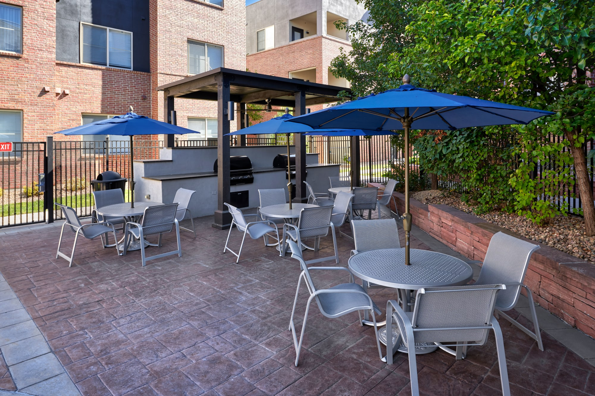 Covered poolside BBQ and lounge area at The Rail at Inverness in Englewood, Colorado