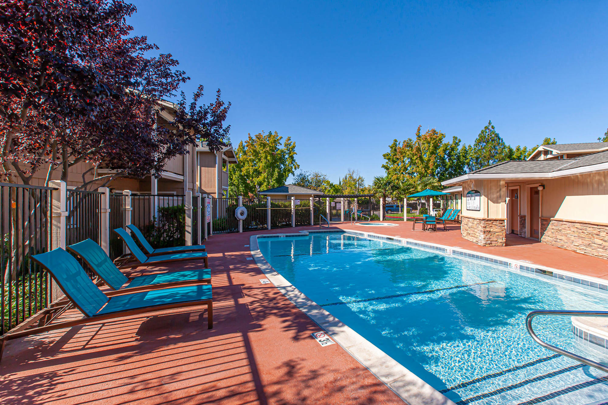 Swimming Pool with lounge Chairs at Sommerset Apartments in Vacaville, CA