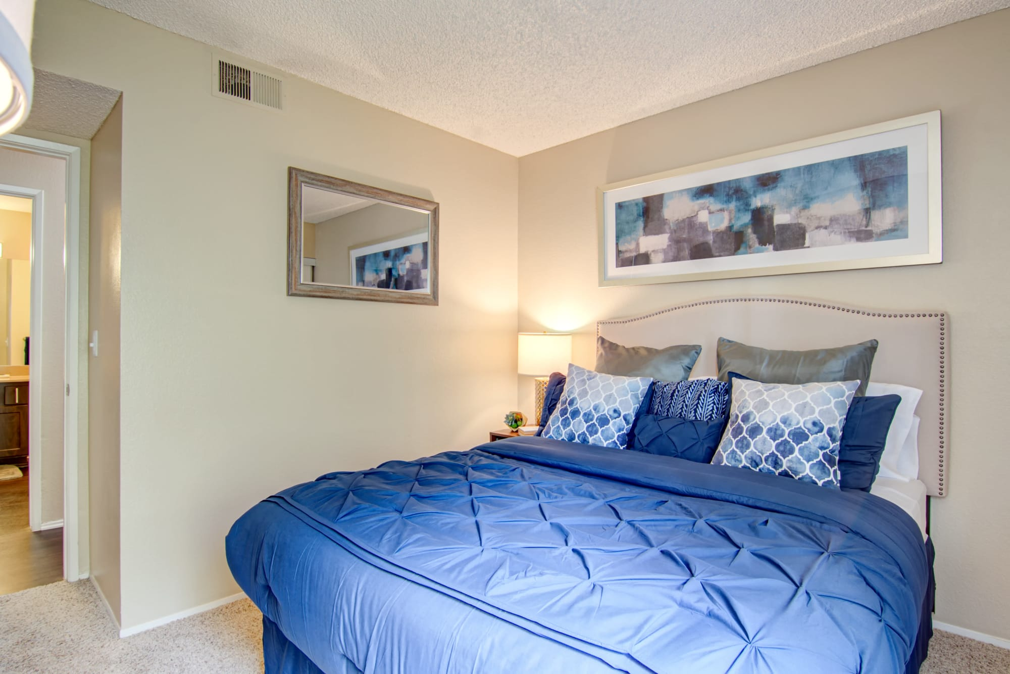 A bedroom at Lakeview Village Apartments in Spring Valley, California