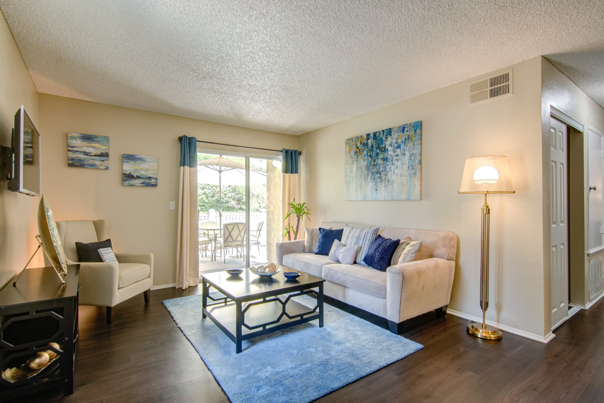 A spacious living room and hallway at Lakeview Village Apartments in Spring Valley, California