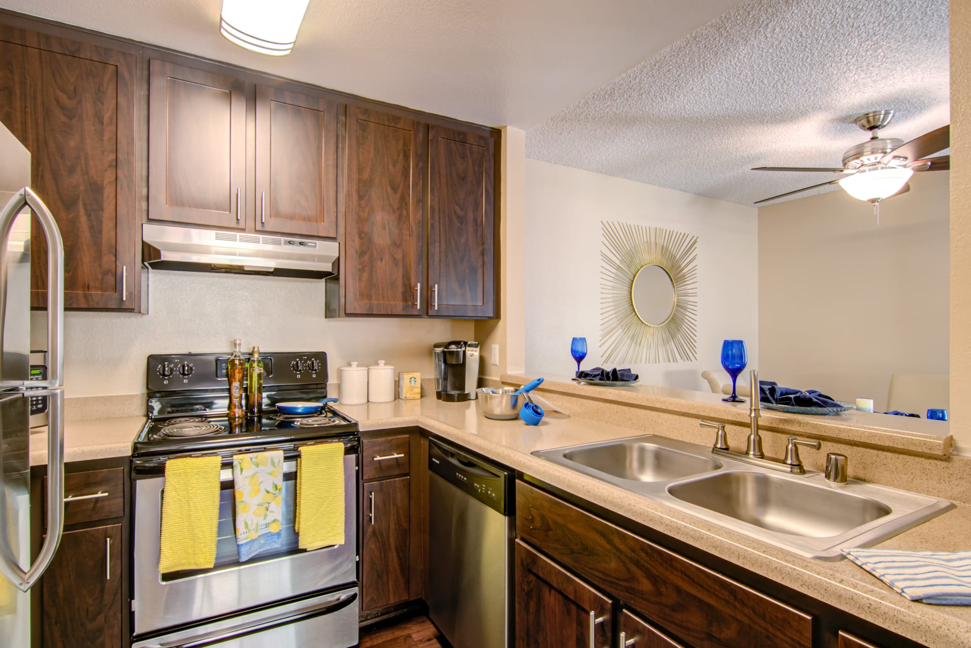 Renovated kitchen with stainless steel appliances at Lakeview Village Apartments in Spring Valley, California