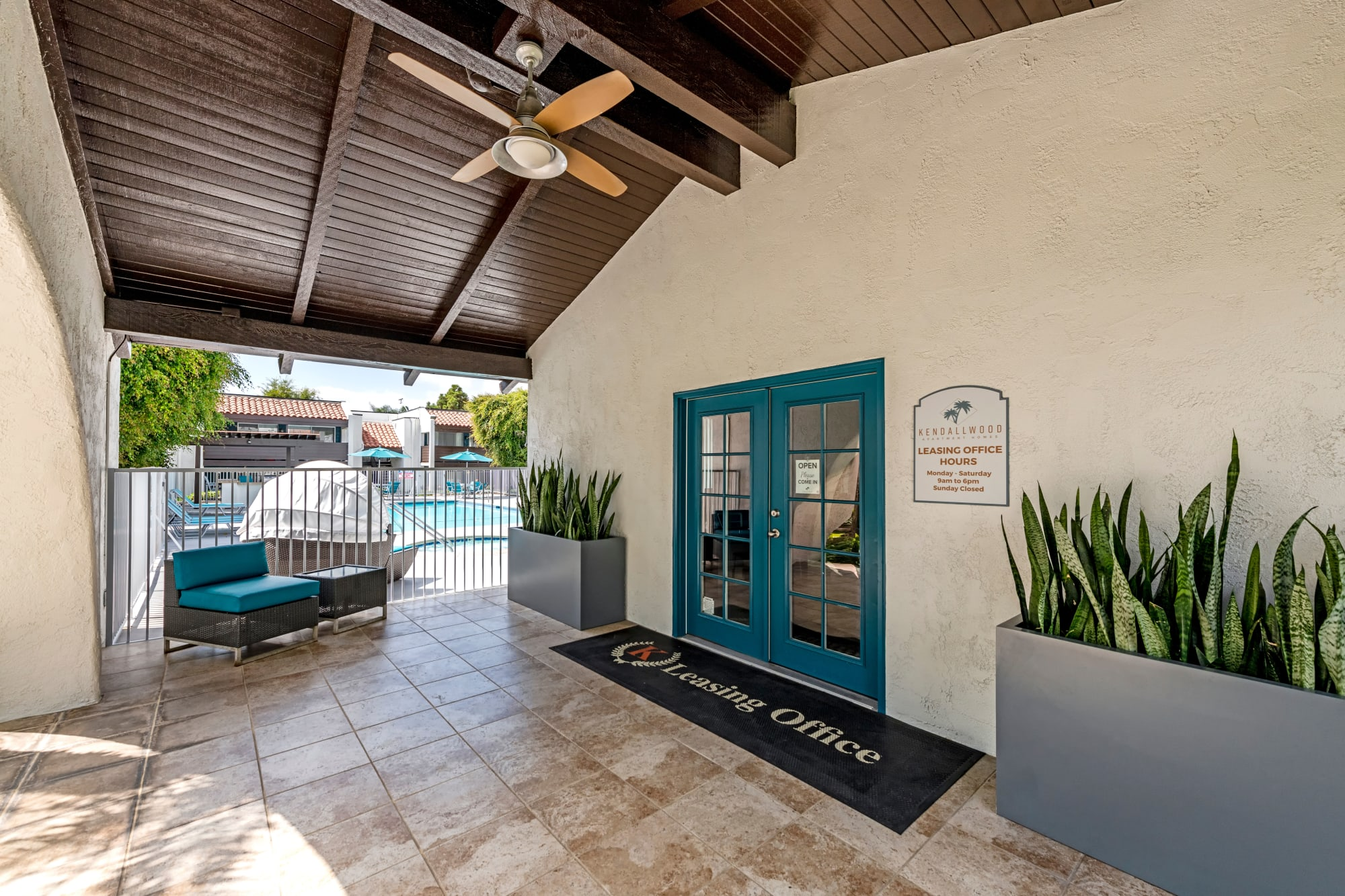 The covered outdoor entry to the leasing office at Kendallwood Apartments in Whittier, California