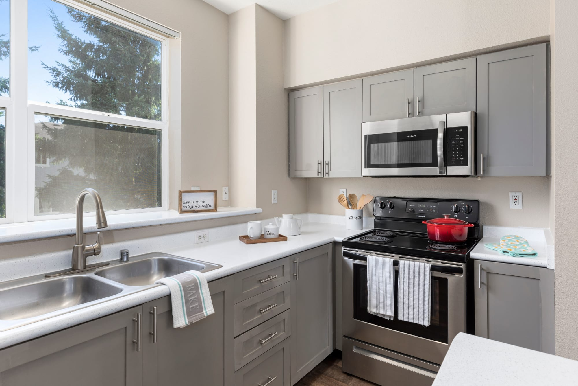 Kitchen with stainless steel appliances at HighGrove Apartments in Everett, Washington