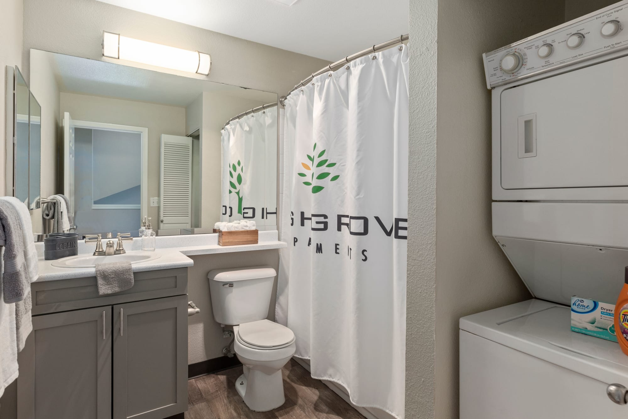 A model bathroom with grey cabinetry at HighGrove Apartments in Everett, Washington