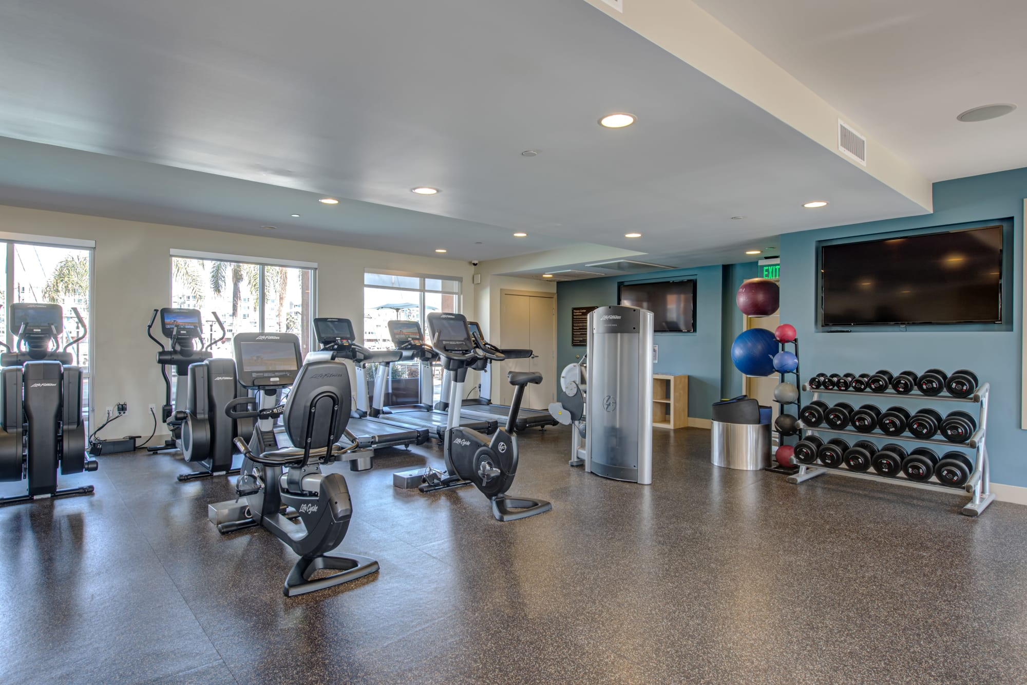 Enjoy working out at the community gym at Harborside Marina Bay Apartments in Marina del Rey, California