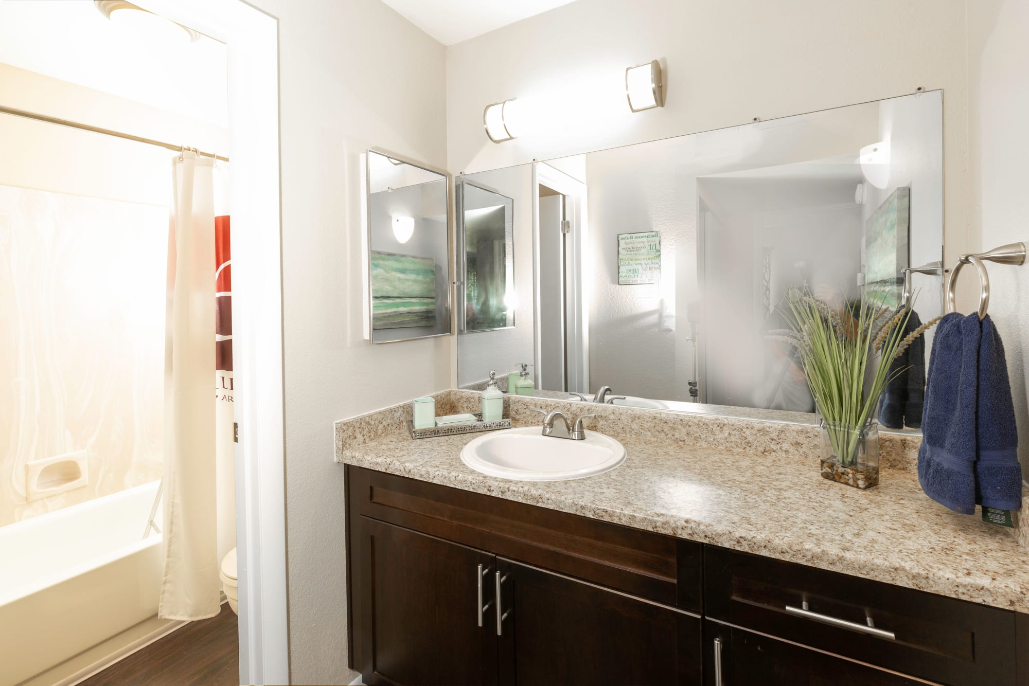 Ample counter space and a large mirror in a bathroom at Callaway Apartments in Taylorsville, Utah