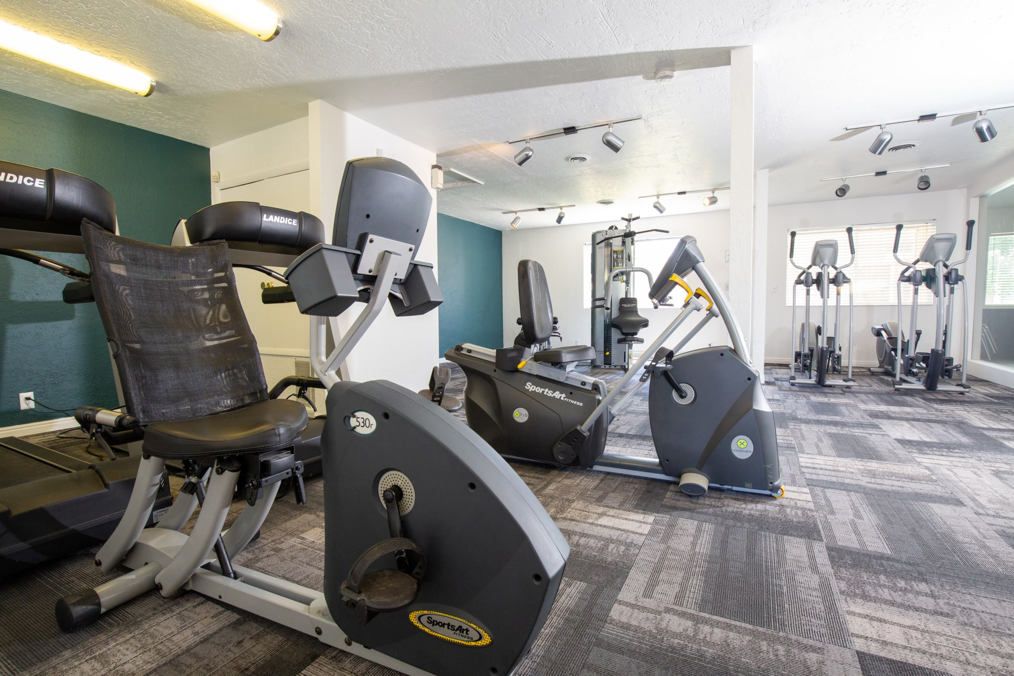 Fitness center with cardio machines at Callaway Apartments in Taylorsville, Utah