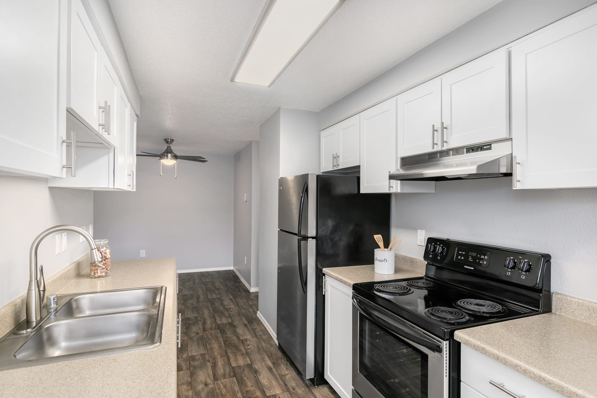 Newly renovated white kitchen with stainless steel appliances at Walnut Grove Landing Apartments in Vancouver, WA