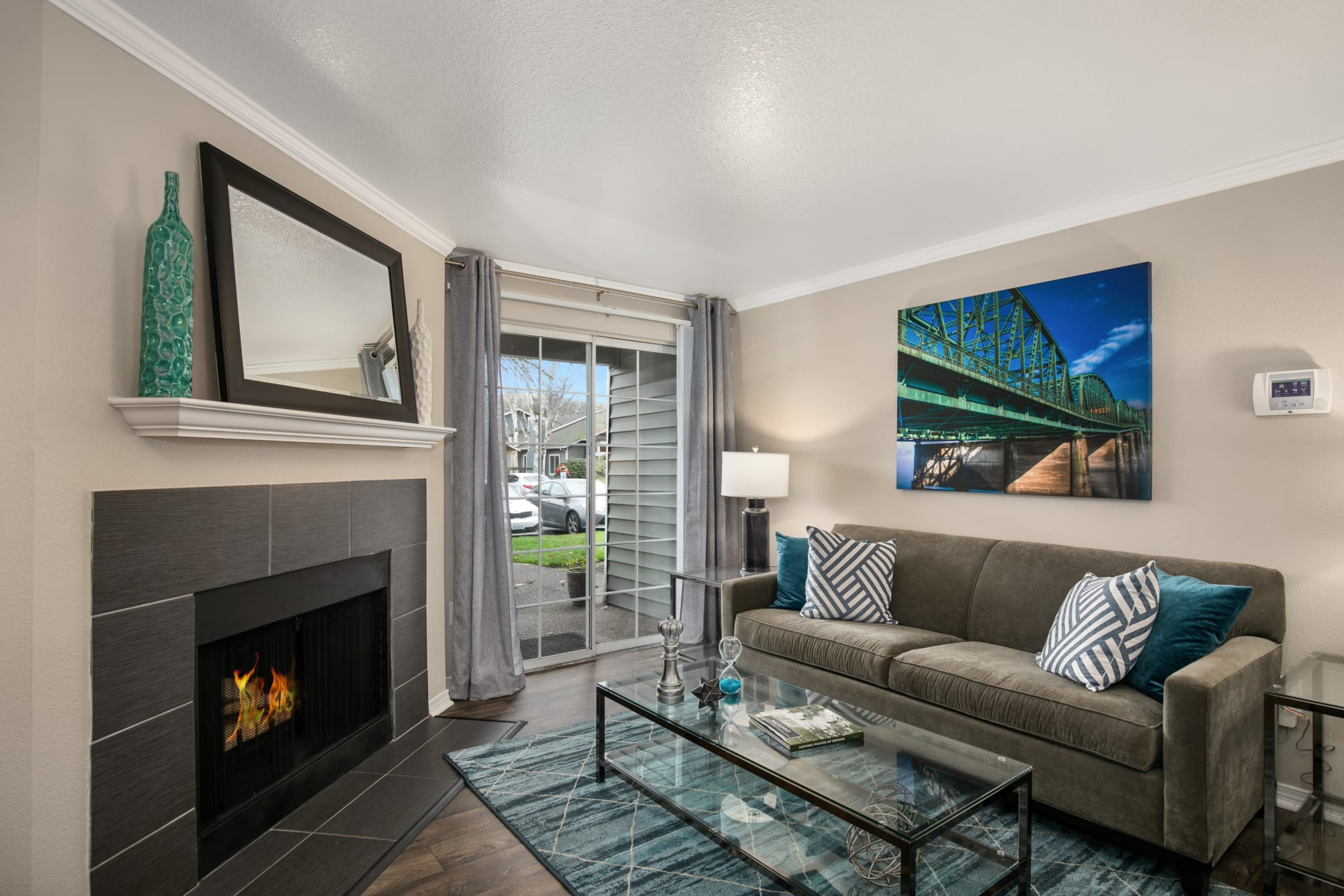Living Room Model with Fireplace at Walnut Grove Landing Apartments in Vancouver, WA