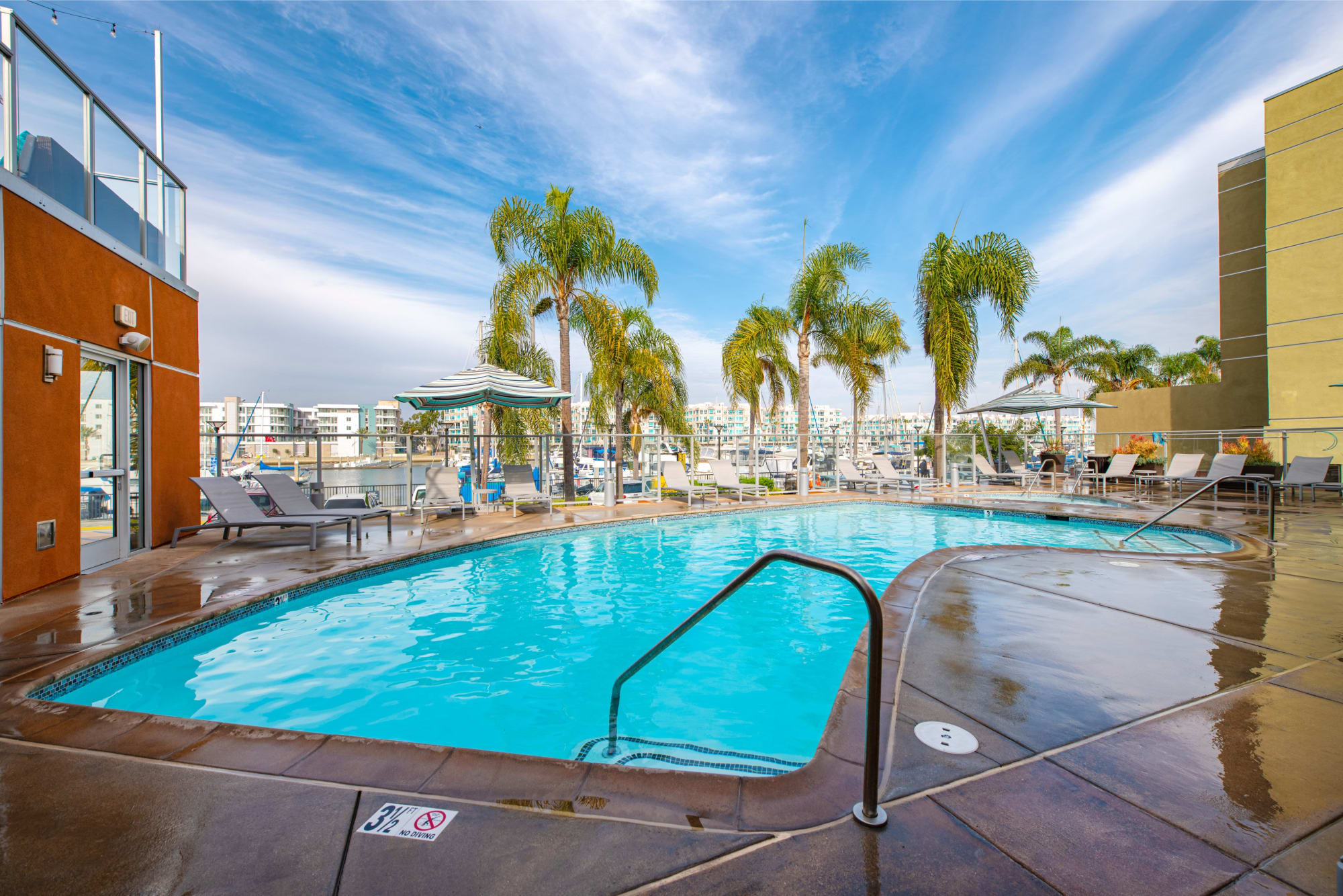 Beautiful, sparkling blue swimming pool at Harborside Marina Bay Apartments in Marina del Rey, California
