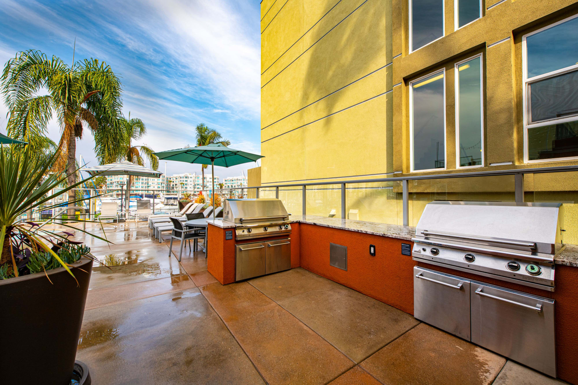 Outdoor barbecue area at Harborside Marina Bay Apartments in Marina del Rey, California