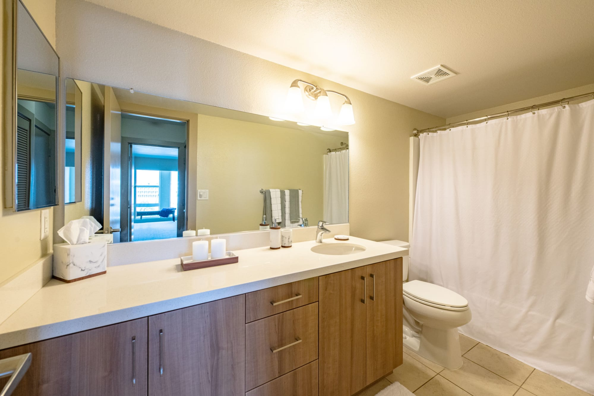Bathrooms with ample counter space at Harborside Marina Bay Apartments in Marina del Rey, California