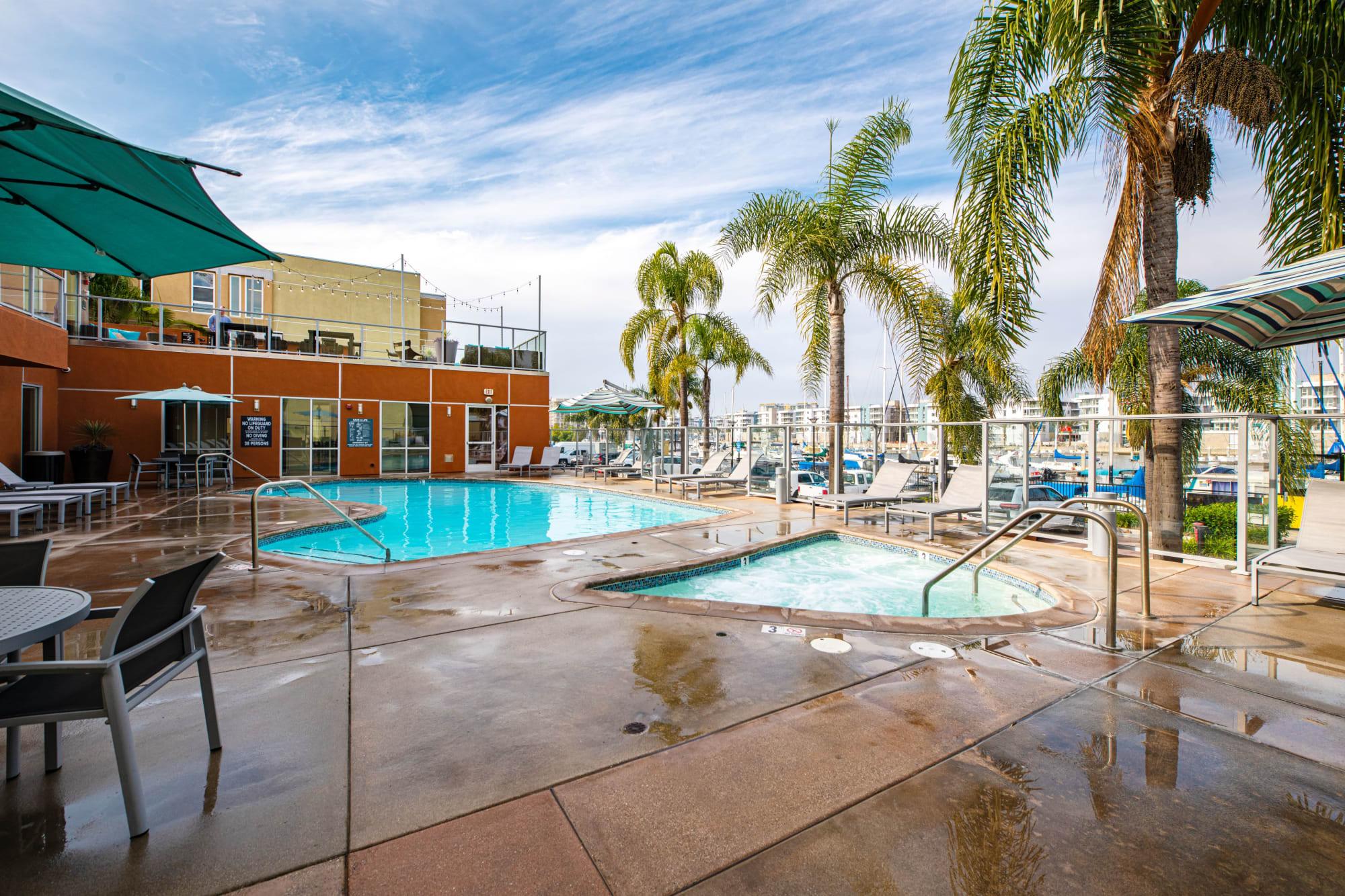Hot tub and lounge chairs at Harborside Marina Bay Apartments in Marina del Rey, California