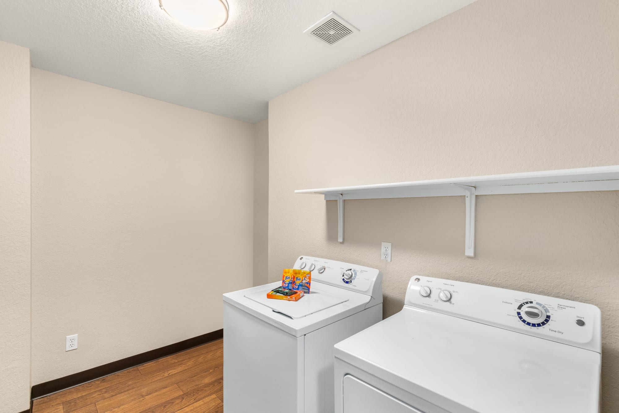 Full sized washer and dryer included in apartments at Carriage Park Apartments in Vancouver, Washington