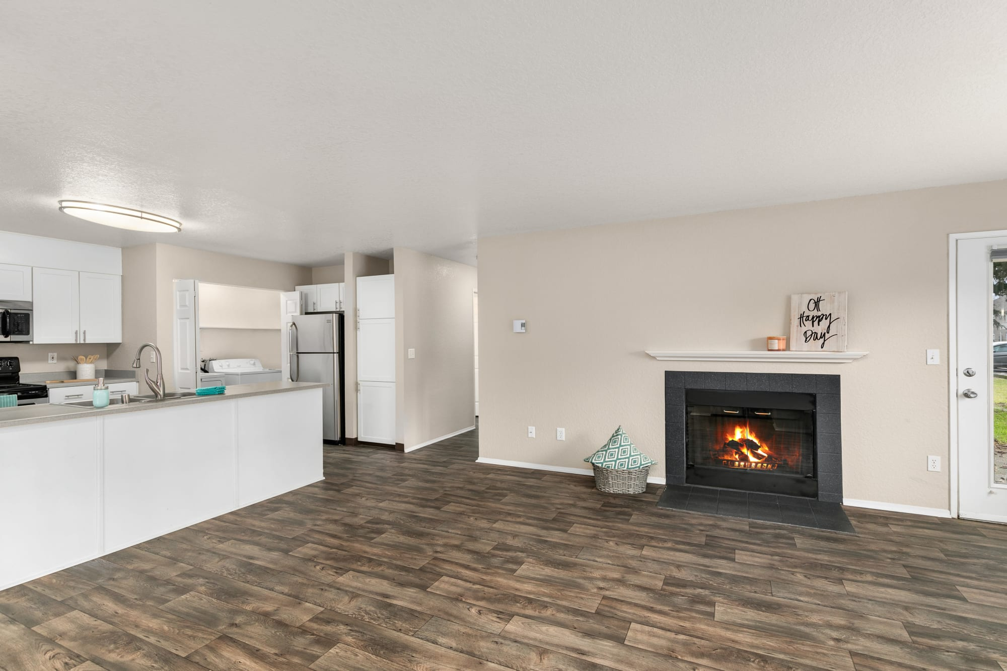 living room with fireplace at Carriage Park Apartments