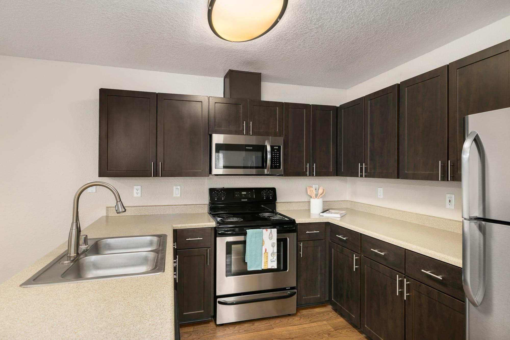 Well organized kitchen, brown spec renovation at Carriage Park Apartments in Vancouver, WA