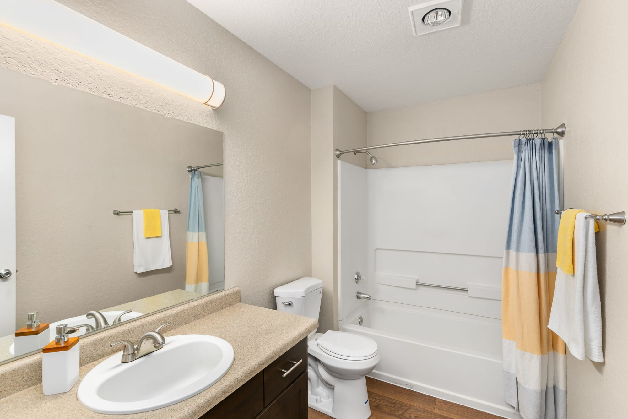 Renovated bathroom with espresso cabinetry at Carriage Park Apartments in Vancouver, Washington