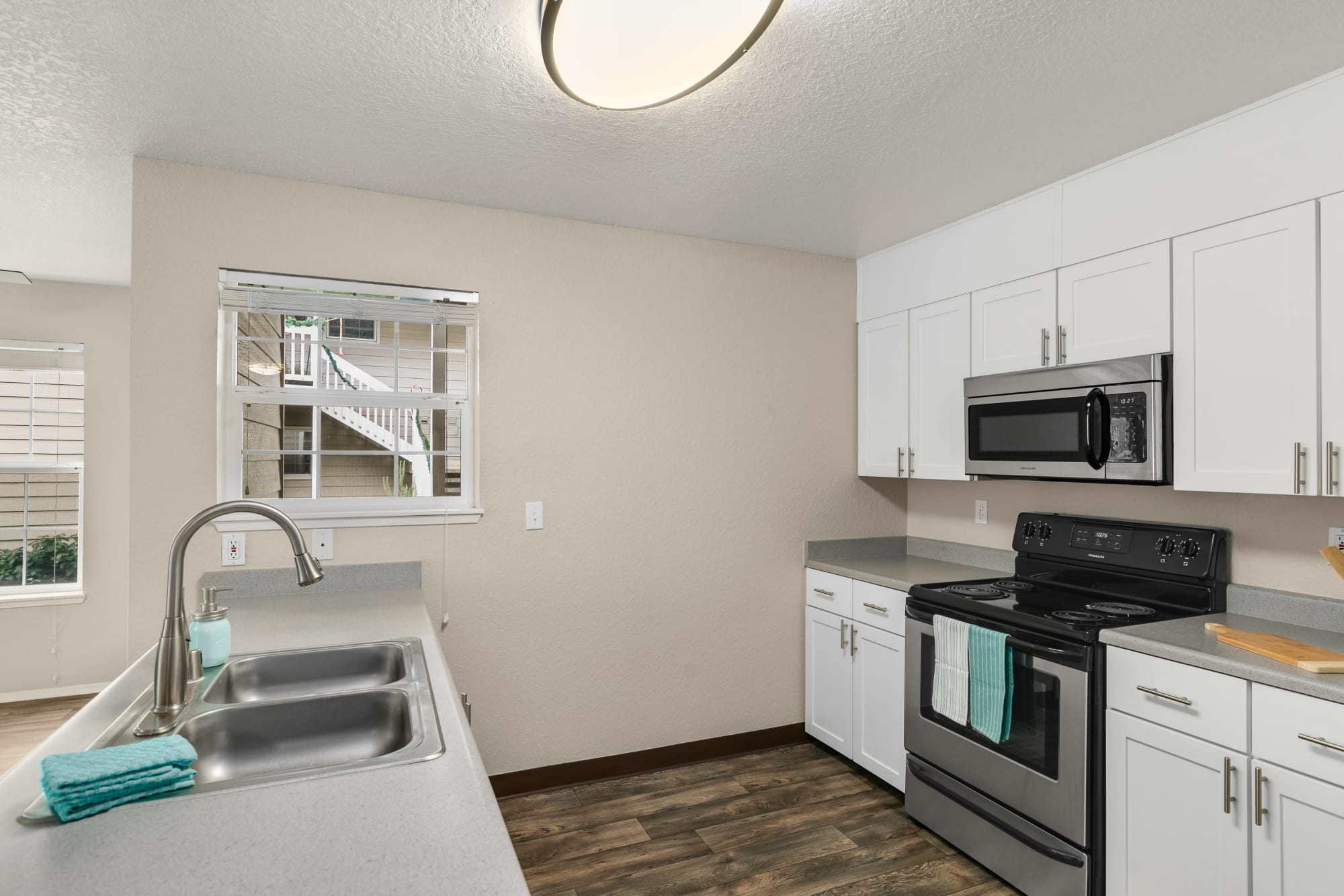 Recently renovated kitchen with white cabinet doors at Carriage Park Apartments in Vancouver, Washington
