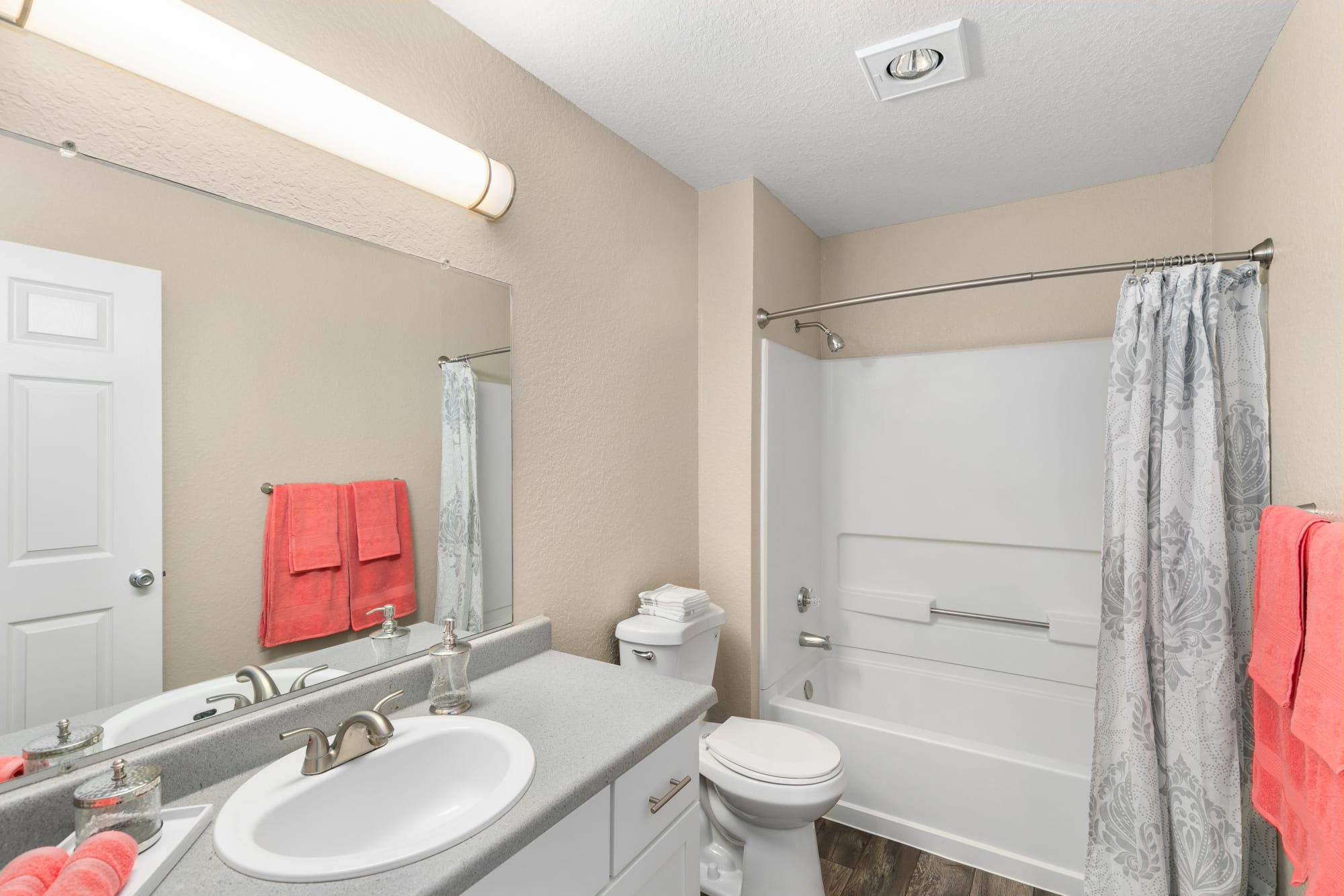 Updated bathroom with a large mirror and tub at Carriage Park Apartments in Vancouver, Washington