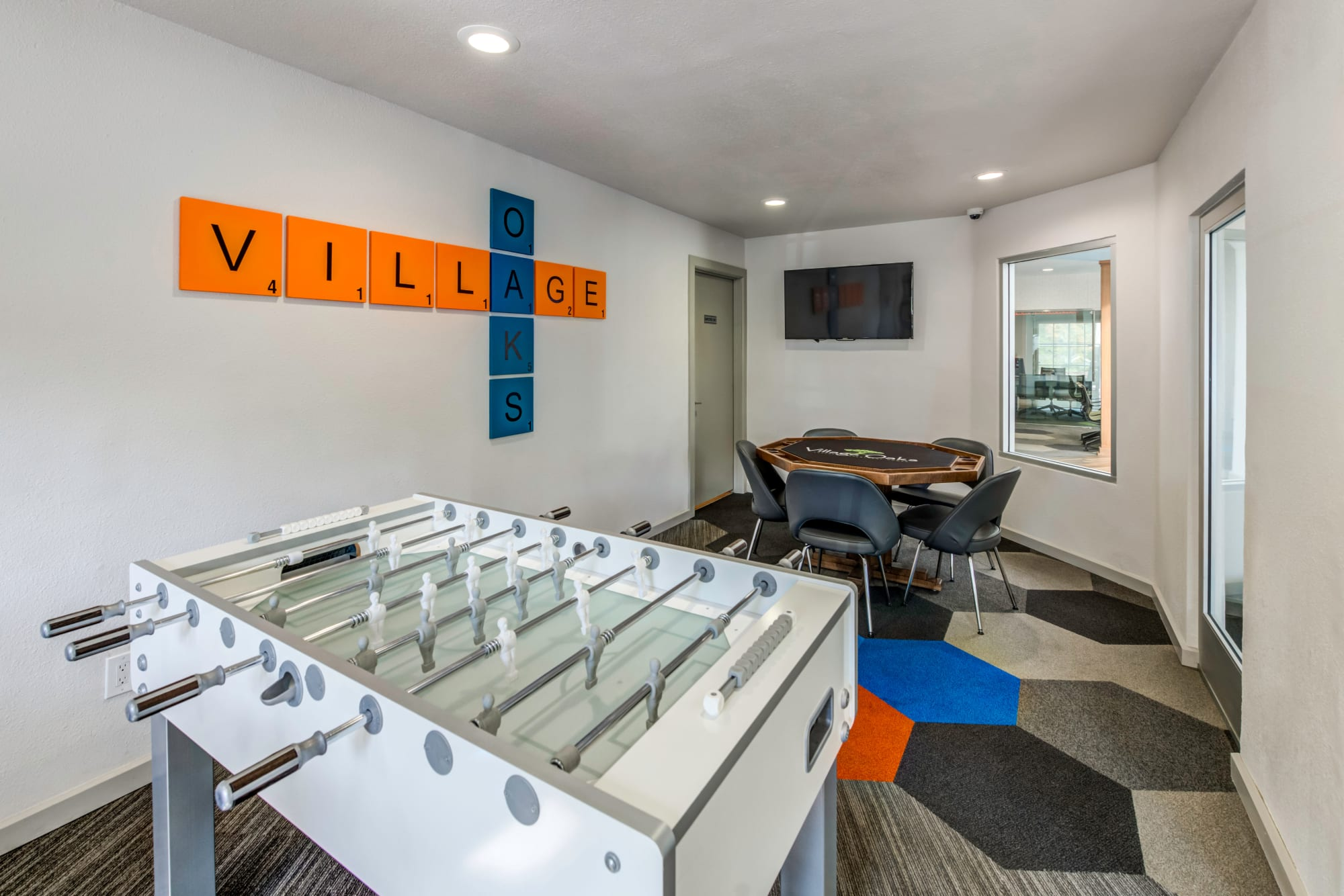 Game room with Foosball and a poker table at Village Oaks in Chino Hills, California