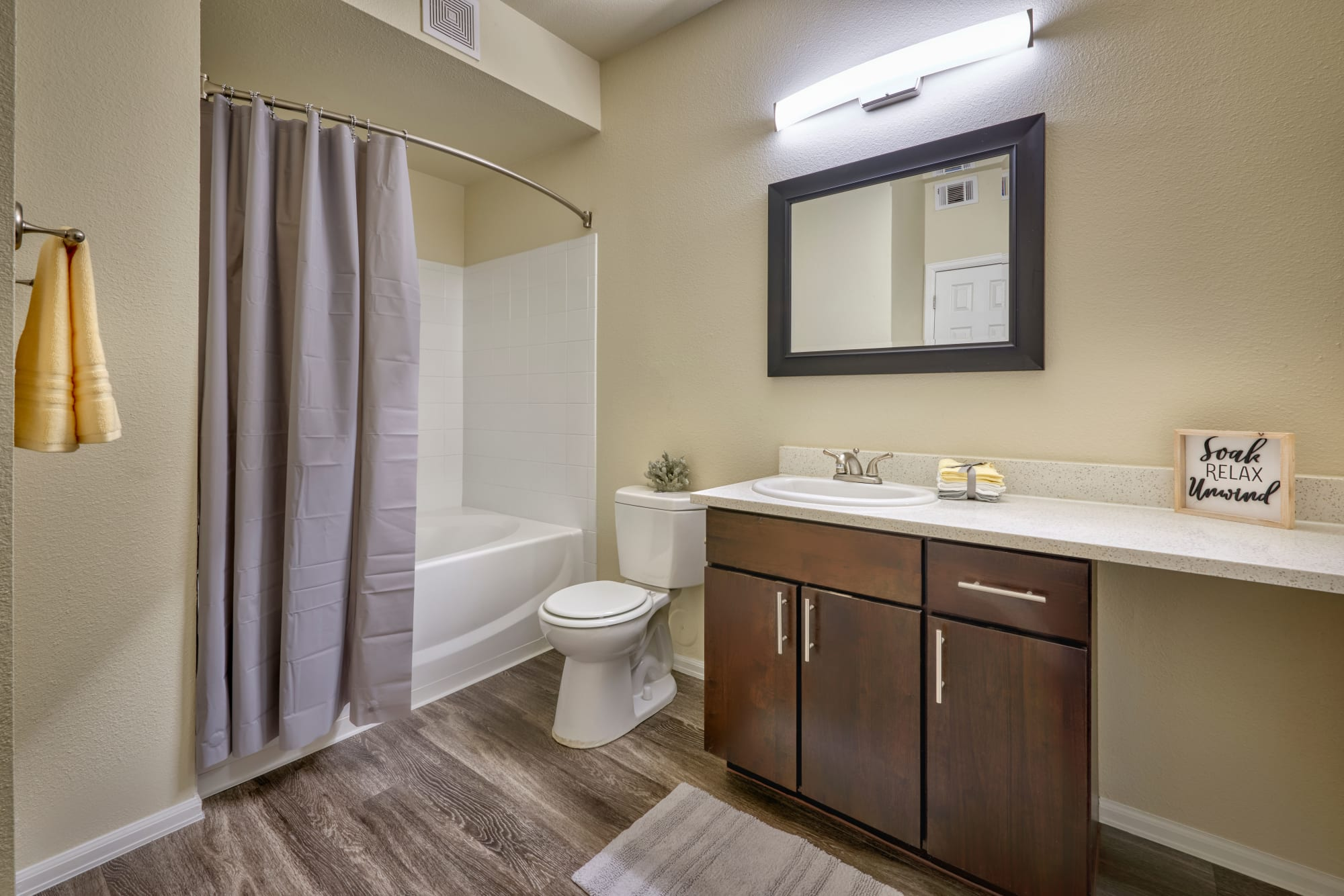 A bathroom with a bathtub at The Crossings at Bear Creek Apartments in Lakewood, Colorado